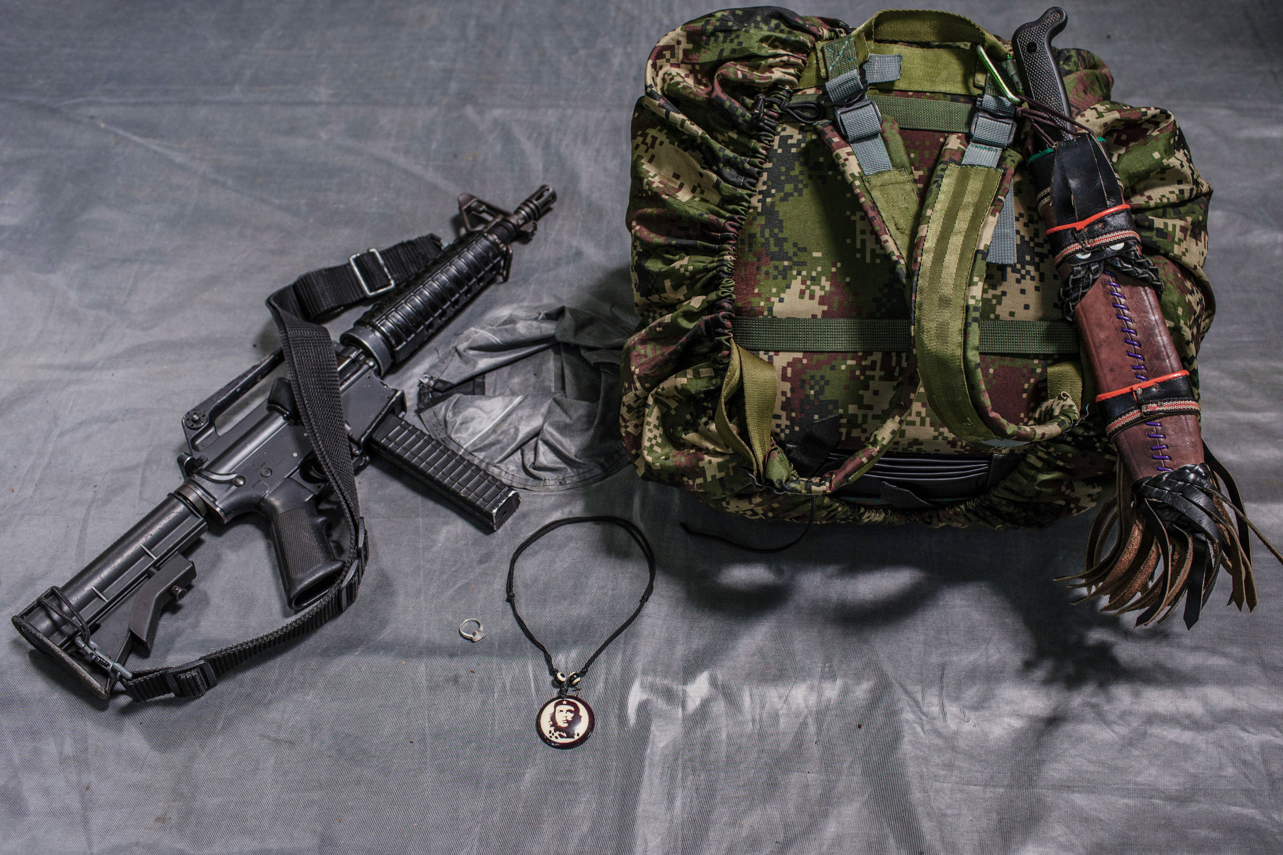 The backpack carried by 31-year-old FARC commander,  Brenda.  She has been a member of FARC for 15 years. Besides, her rifle, pistol, and commuter for intelligence mission, she always has space in her backpack for nail polish and perfume.  Her boyfriend is also a member of FARC.