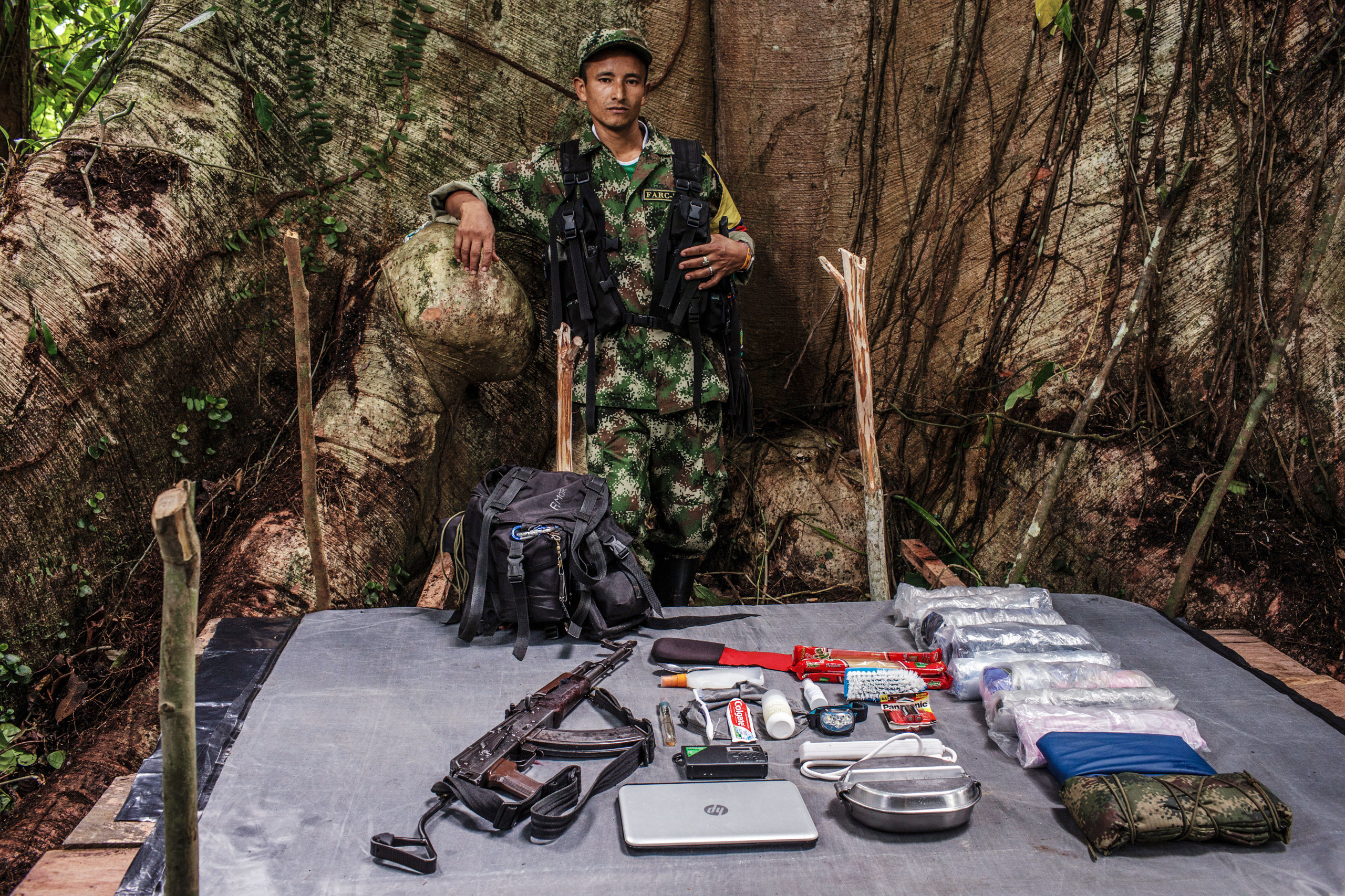 Didier, 37 years old, has been with FARC for 19 years.                                He carries an AK47 and  a laptop  for intelligence missions.