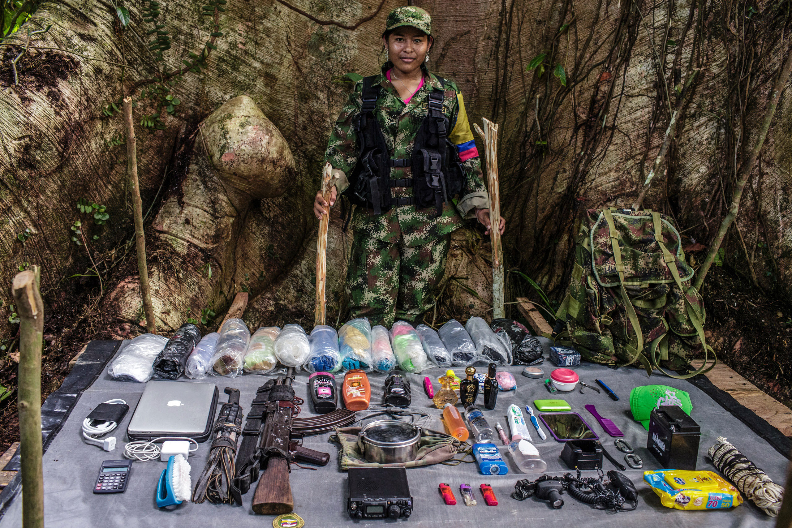 Marcela , 18-years old,  has been with FARC for two years.                                She is from an indigenous community that was attacked by a paramilitaries, and afterward she jointed FARC.  As a  radio operator, she carries a lot of gear for the group, including a laptop, radio, and batteries.