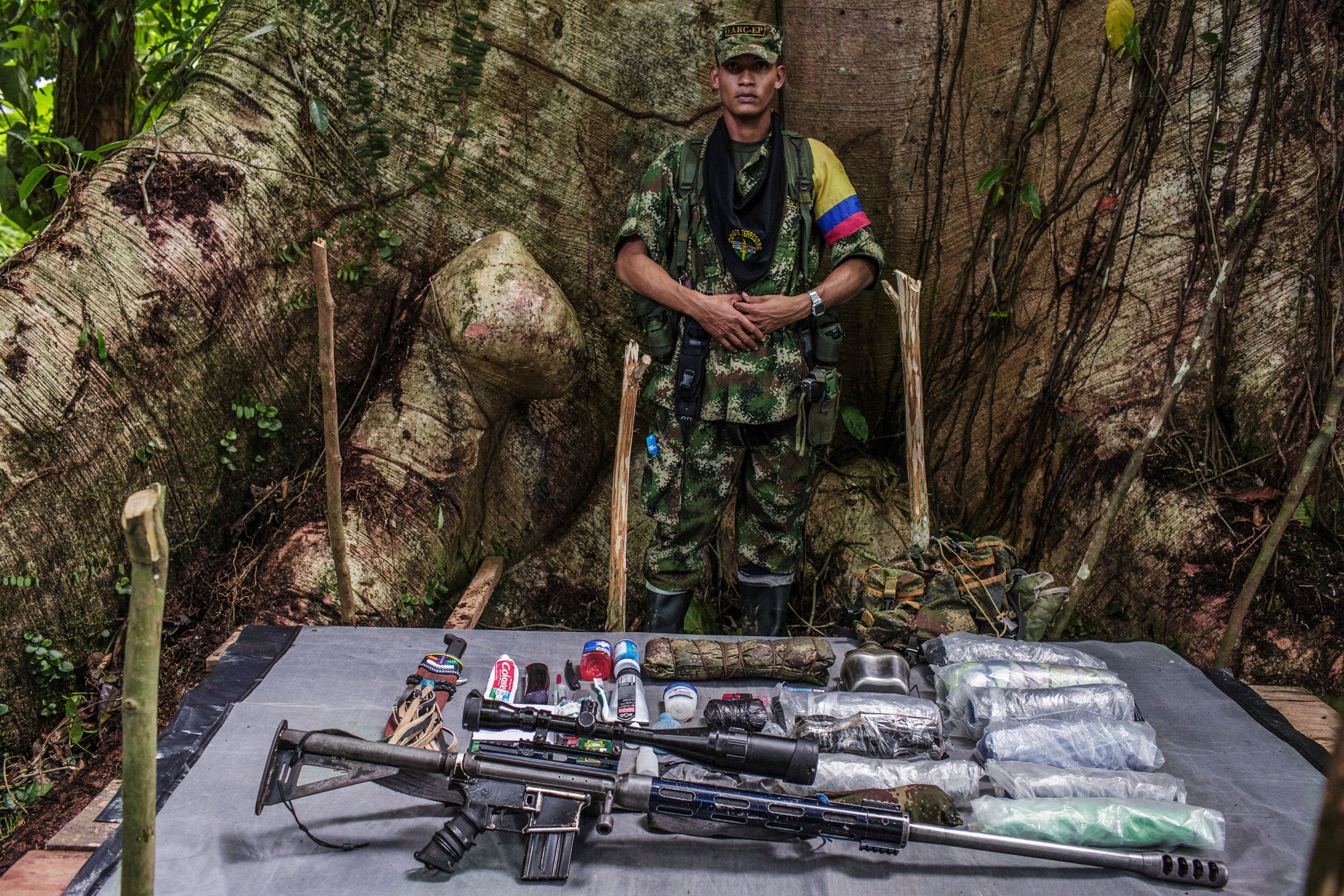 Oswaldo,  22-years old, has been with FARC for 10 years.                                Because OswaldoÕs position is on the frontline, he is armed with heavy artillery. His weapon is handcrafted to combine a .50 rifle and a machine gun.