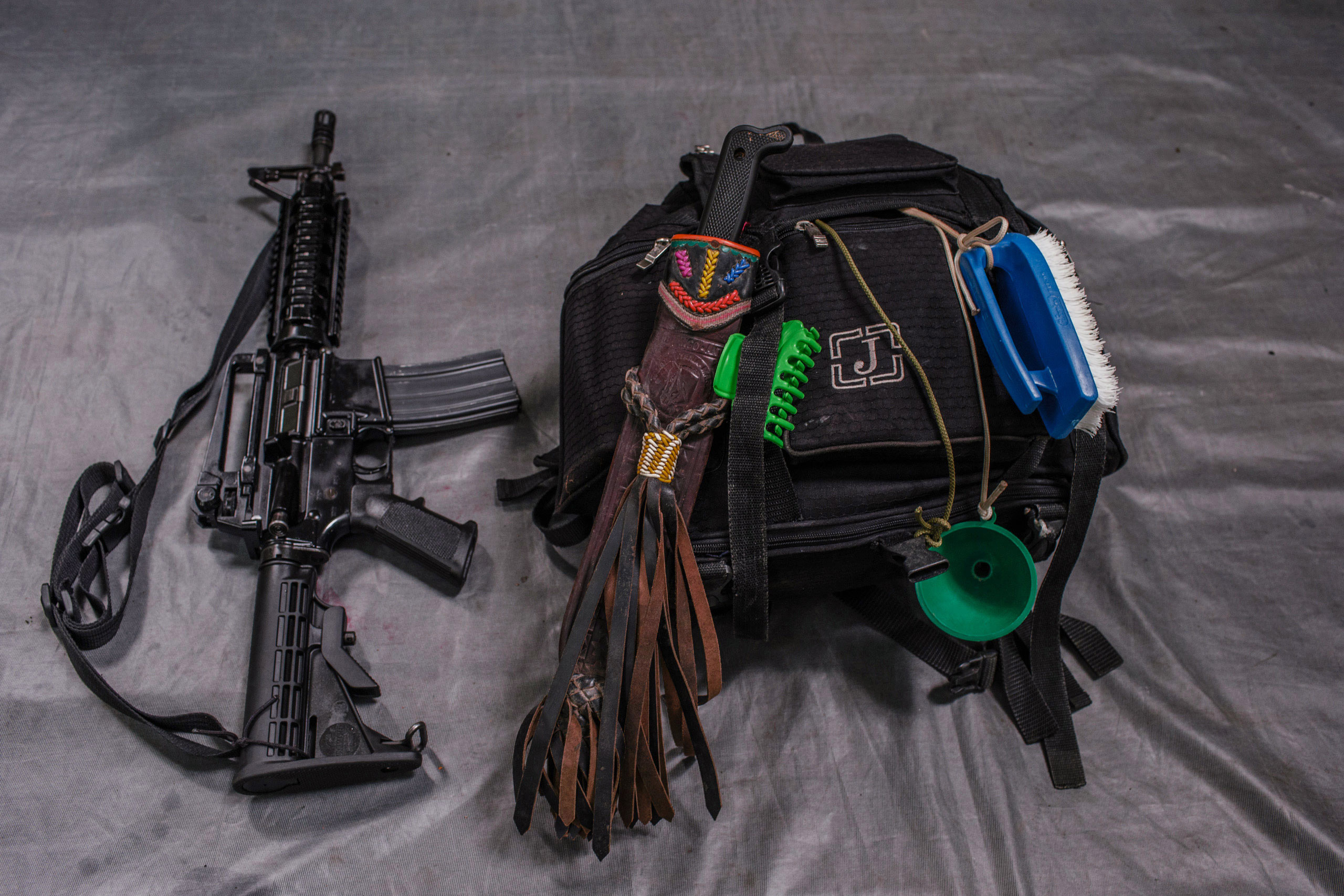 The backpack and M15 rifle that belong to  Glodis , a 33-year old who has been a FARC member for 19 years. She uses the  brush attached to her bag to wash clothes.