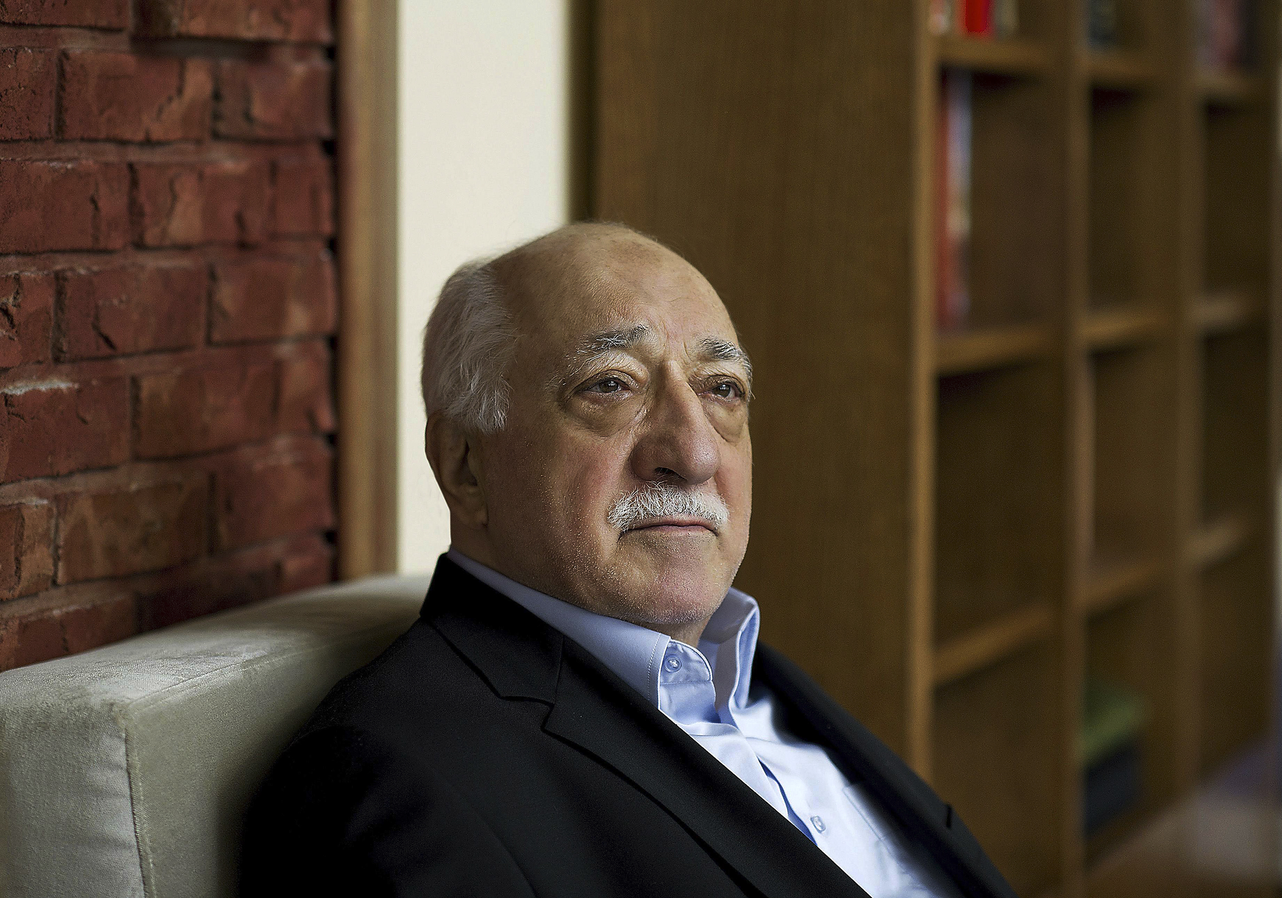 In this March 15, 2014, file photo, Turkish Islamic preacher Fethullah Gulen sits in his residence in Saylorsburg, Pa.
