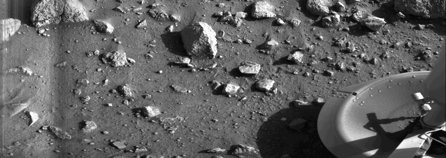 Taken by the Viking 1 lander shortly after it touched down, this image is the first photograph ever taken from the surface of Mars, July 20, 1976.