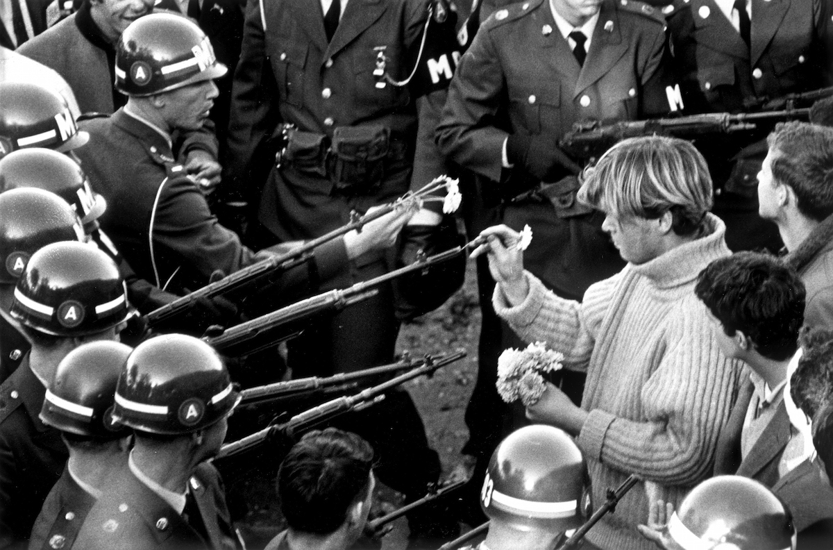 Antiwar demonstrators tried flower power on MPs blocking the Pentagon Building in Arlington, Va., on Oct. 26, 1967.