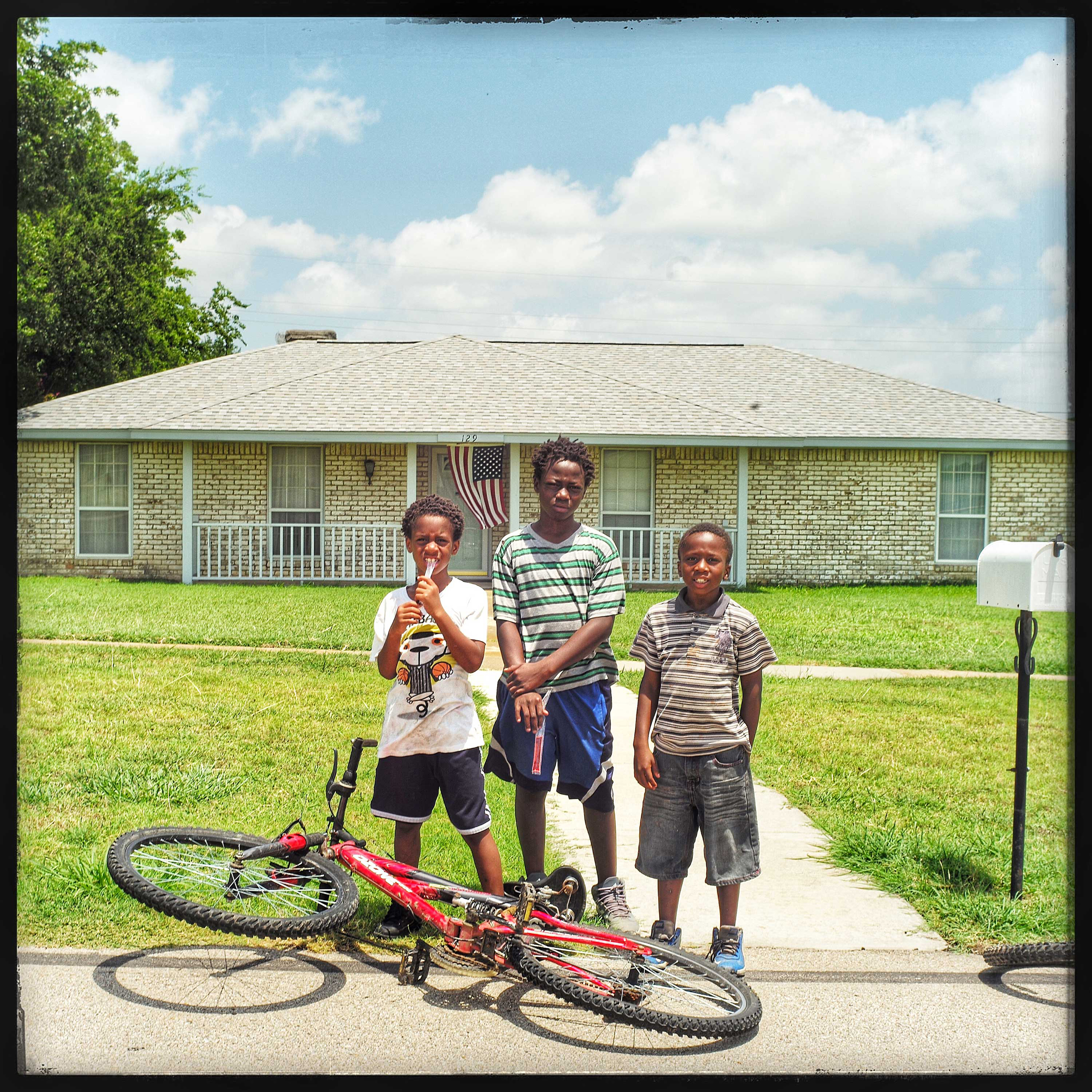 Dallas, Tex: Daylon, Saveon, and Kevon were all riding their bicycles when I stopped them to talk about what was going on in Dallas.                                It's too sad. The police arrest people who don't have a driver's license. They should go after the robbers and killers instead,  Daylon (middle) said.                               Savion (right) said the police should leave guys who sell drugs. They should be able to continue to sell drugs.                                Daylon,  No!!!!!! They should send them to prison for life .. What if the drugs kill people.                                 The place is quiet now,  Kevon (left) added.