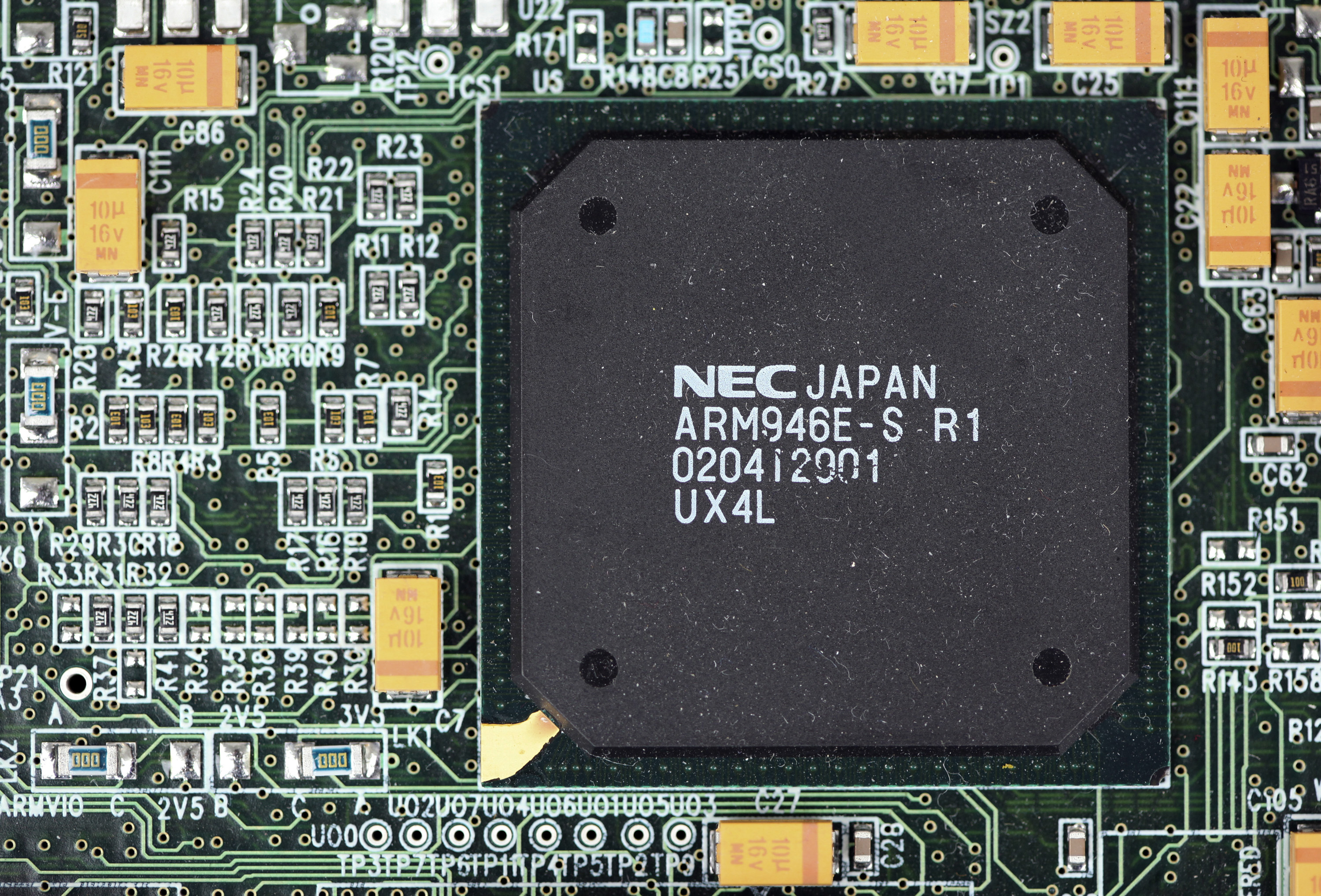 An ARM designed microprocessor chip, made by NEC Corp., sits on display at the ARM Holdings Plc. headquarters in Cambridge, U.K., on Wednesday, March 16, 2011.