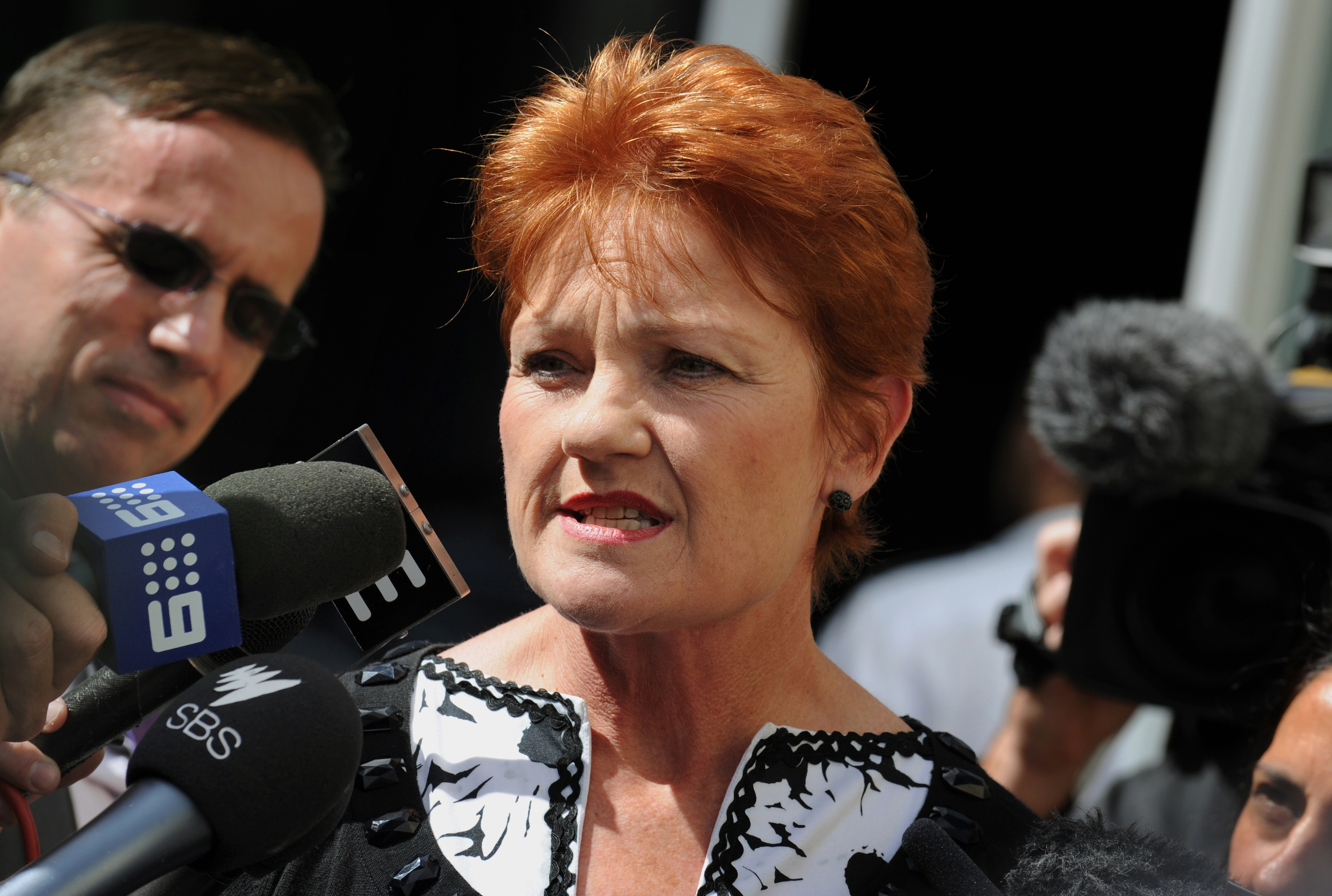 Australian politician Pauline Hanson speaks to the media in Sydney on April 12, 2011, after narrowly failing in her bid to win a seat in the New South Wales parliament