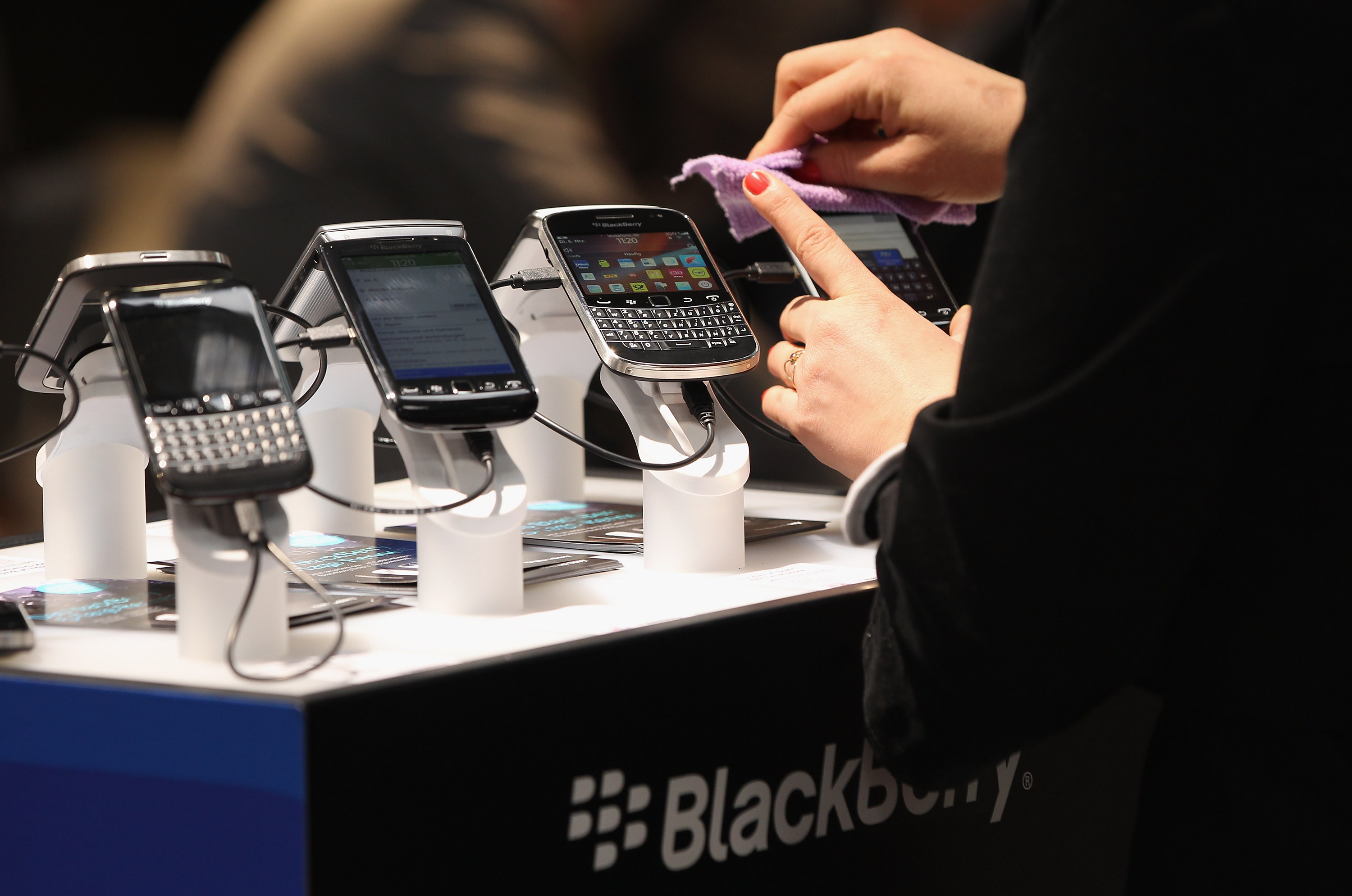 Visitors try out Blackberry smartphones at the Blackberry stand on the first day of the CeBIT 2012 technology trade fair on March 6, 2012 in Hanover, Germany.