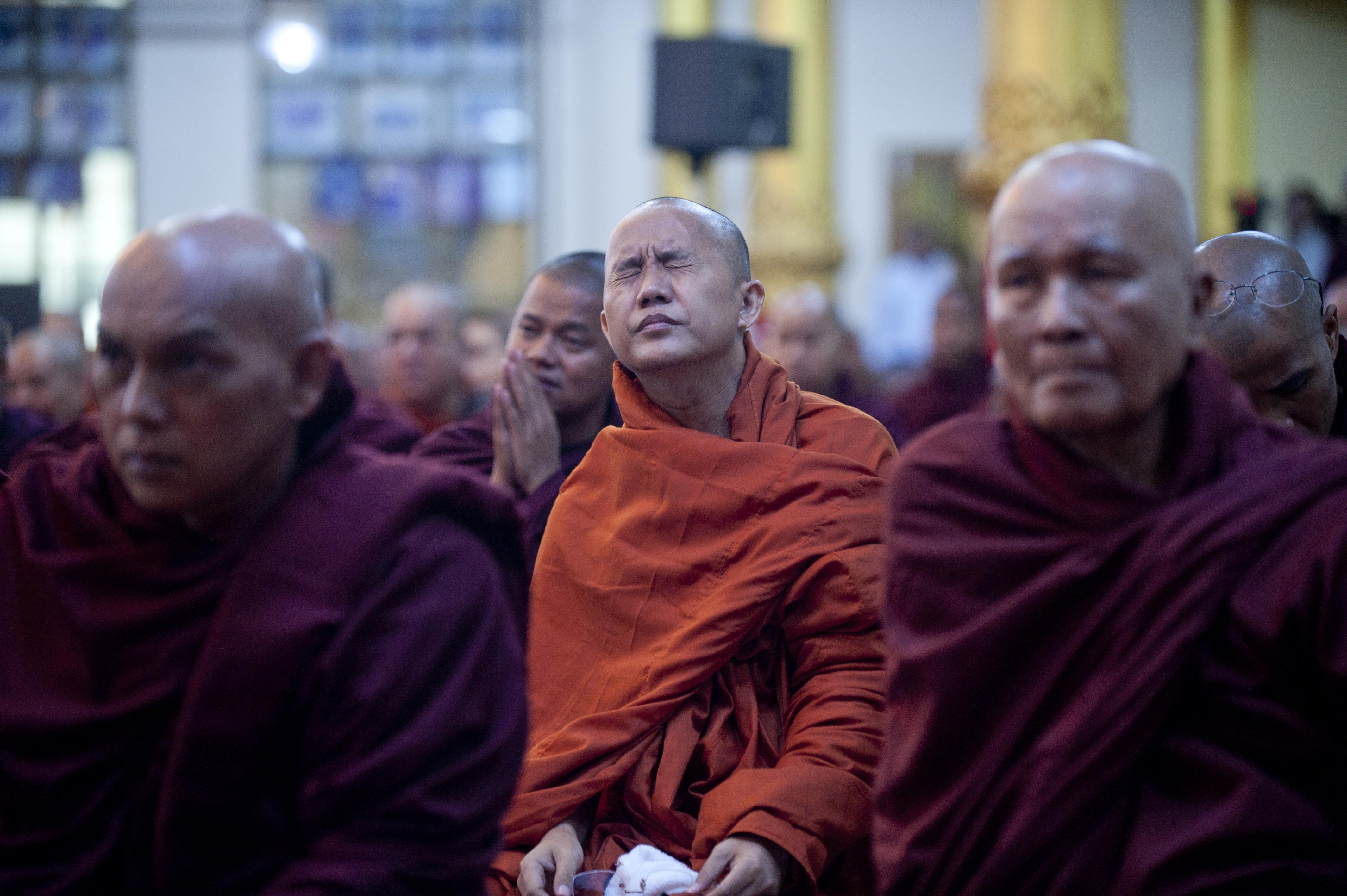 Controversial Burmese monk Wirathu, center, attends a meeting of Buddhist monks at a monastery outside Rangoon, Burma, on June 27, 2013