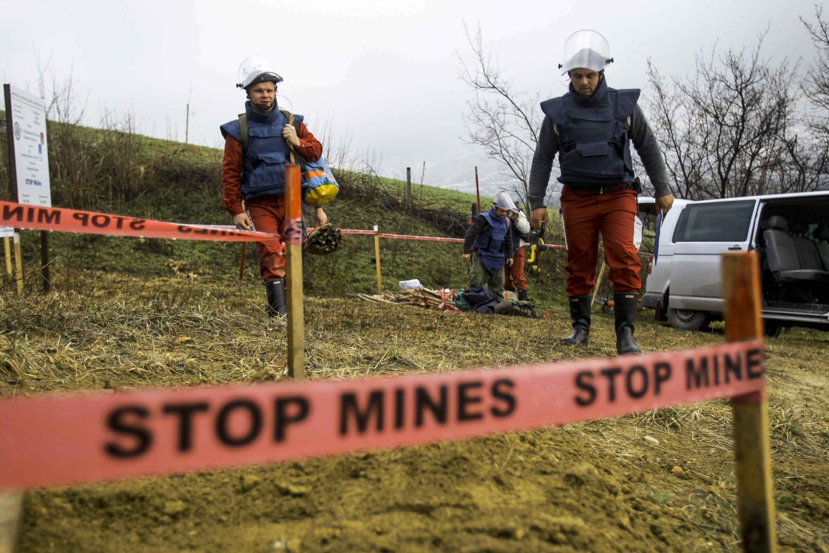 Members of Bosnia and Herzegovina Mine Action Centre (BHMAC) clear landmines at a minefield, in Sarajevo, Bosnia and Herzegovina on April 5, 2015