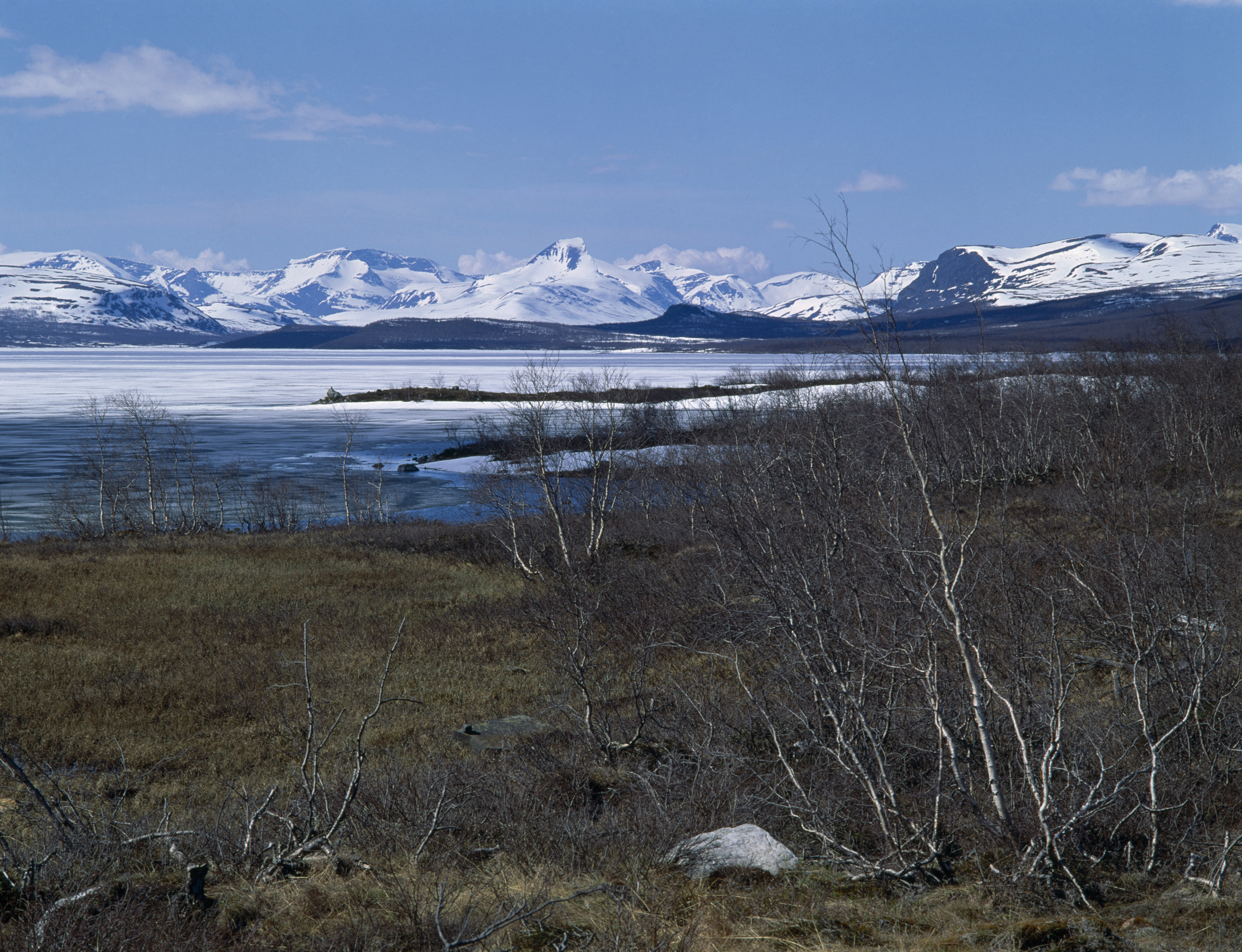 Finland, Lapland, Kilpisjarvi West view Norway, Way of the Four Winds, lake snow capped peaks. (Photo by: Eye Ubiquitous/UIG via Getty Images)
