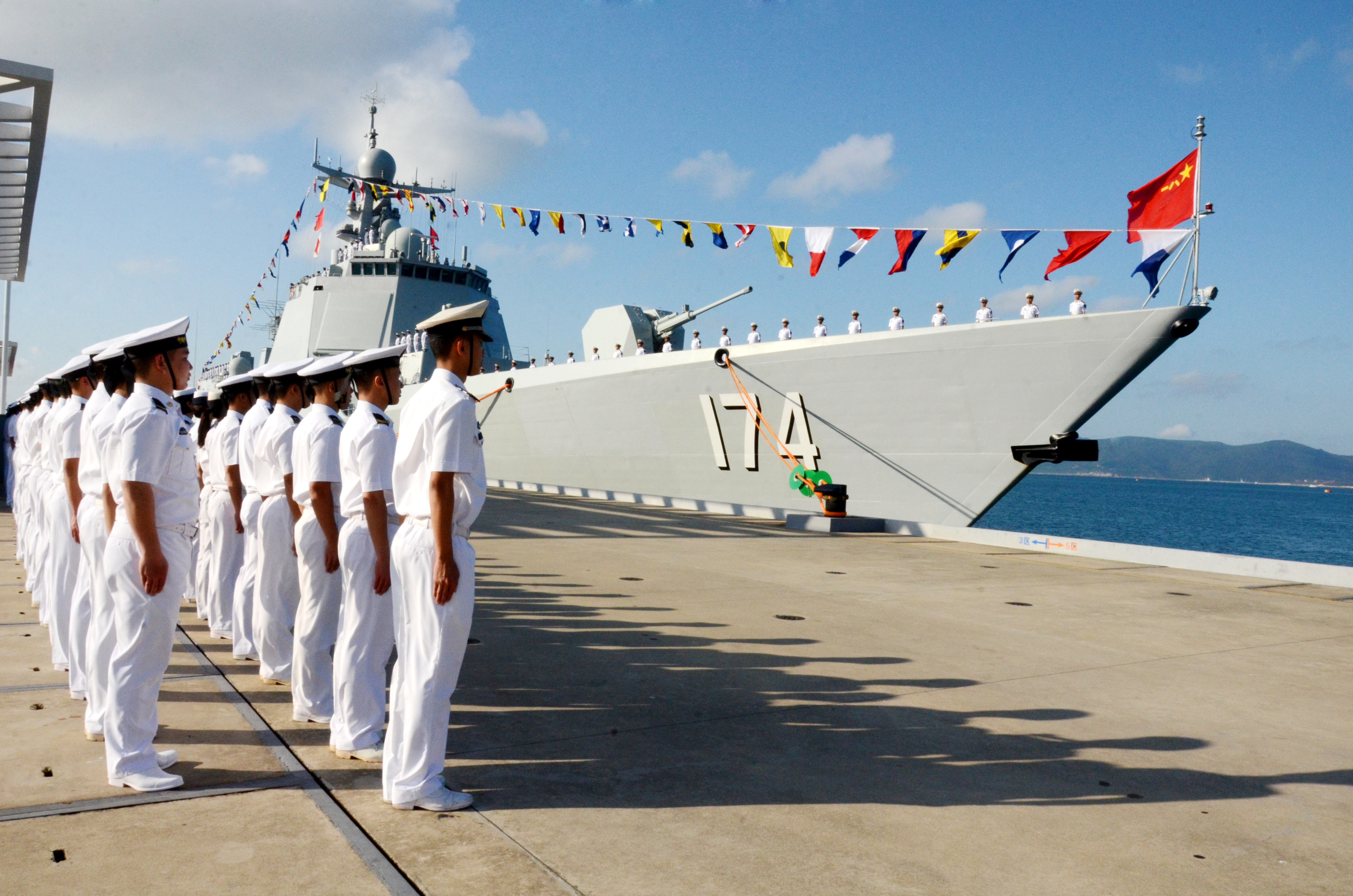Chinese Navy officers attend a flag-presenting ceremony as the Hefei, the third Type 052D guided missile destroyer commissioned by the PLA Navy is delivered to the South Sea Fleet on Dec. 12, 2015, in Sanya, China's Hainan Island