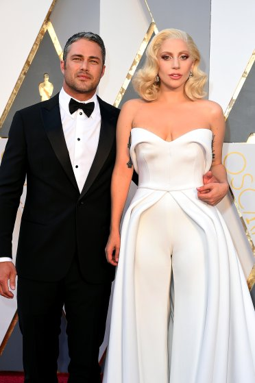 """Lady Gaga and Taylor Kinney: Lady Gaga and Taylor Kinney called off their engagement in July after nearly five years of being together. The pair met on the set of her """"You and I"""" video in 2011 and got engaged on Valentine's Day last year."""