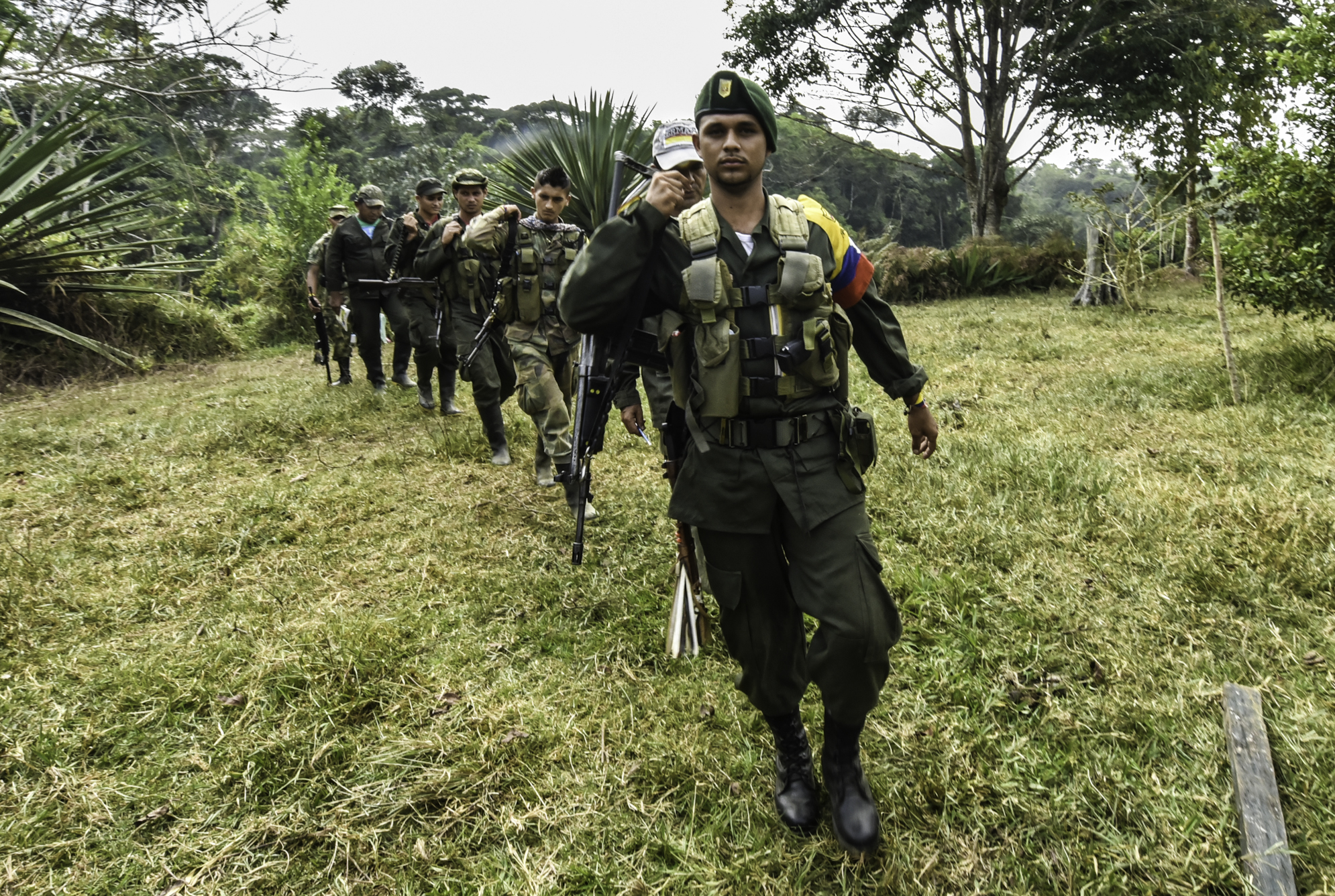 Revolutionary Armed Forces of Colombia (FARC) members patrol a camp in the Magdalena Medio region, Antioquia department, Colombia on February 18, 2016.