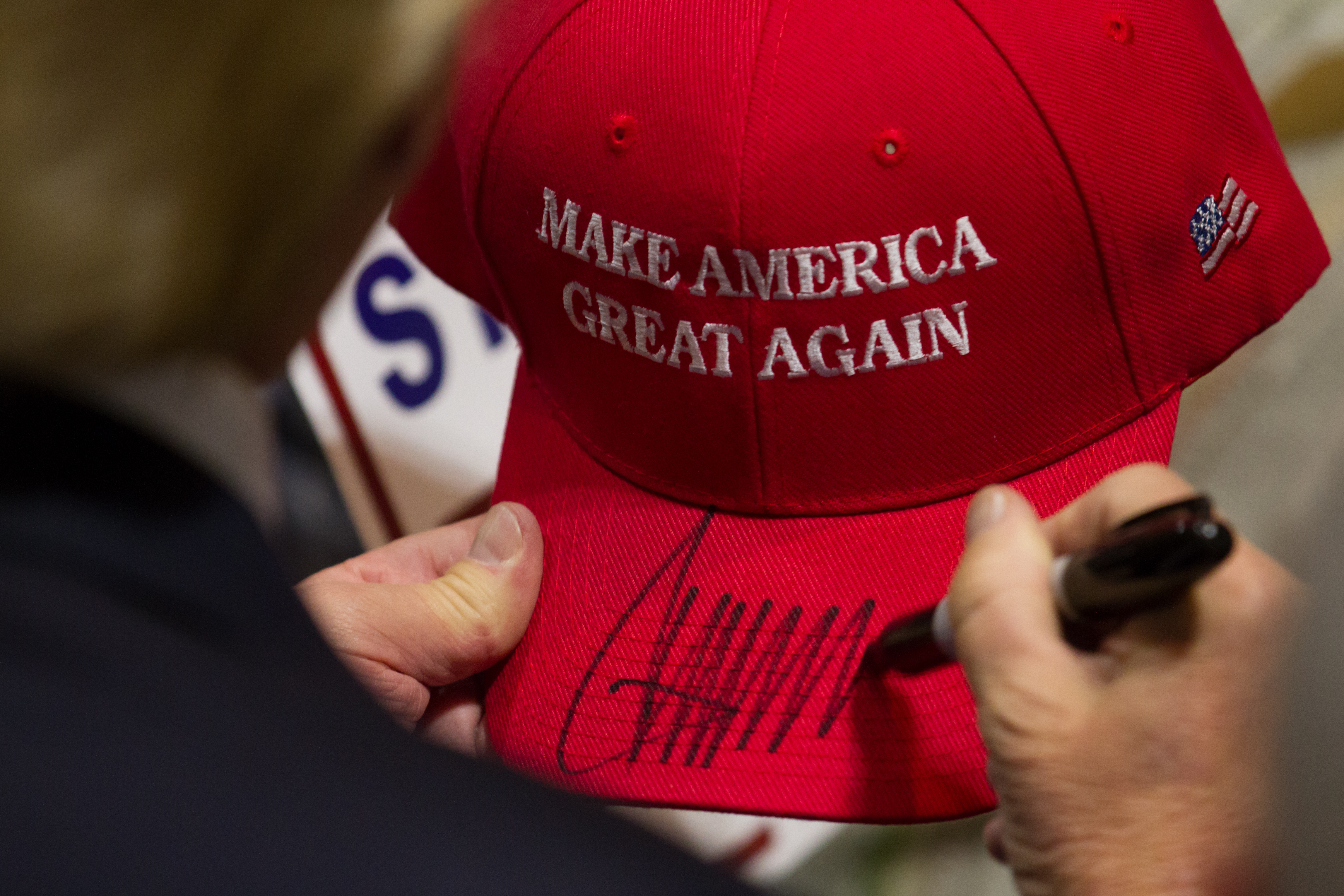 HARTFORD, CT - APRIL 15: Republican presidential candidate Donald Trump signs a hat after speaking at a rally at the Connecticut Convention Center on April 15, 2016 in Hartford, Connecticut. The 2016 Connecticut Republican Primary is scheduled for April 26, 2016. (Photo by Matthew Cavanaugh/Getty Images)