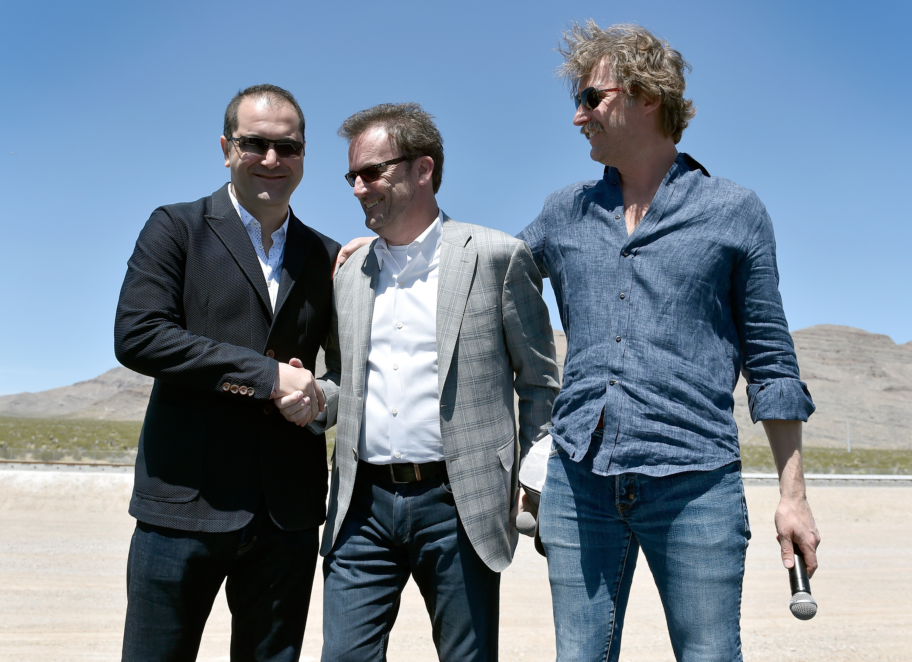 (L-R) Hyperloop One Co-Founder & Executive Chairman Shervin Pishevar, Hyperloop One Chief Executive Officer Rob Lloyd and Co-Founder & Chief Technology Officer Brogan BamBrogan speak during the first test of the propulsion system at the Hyperloop One Test and Safety site on May 11, 2016 in North Las Vegas, Nevada.