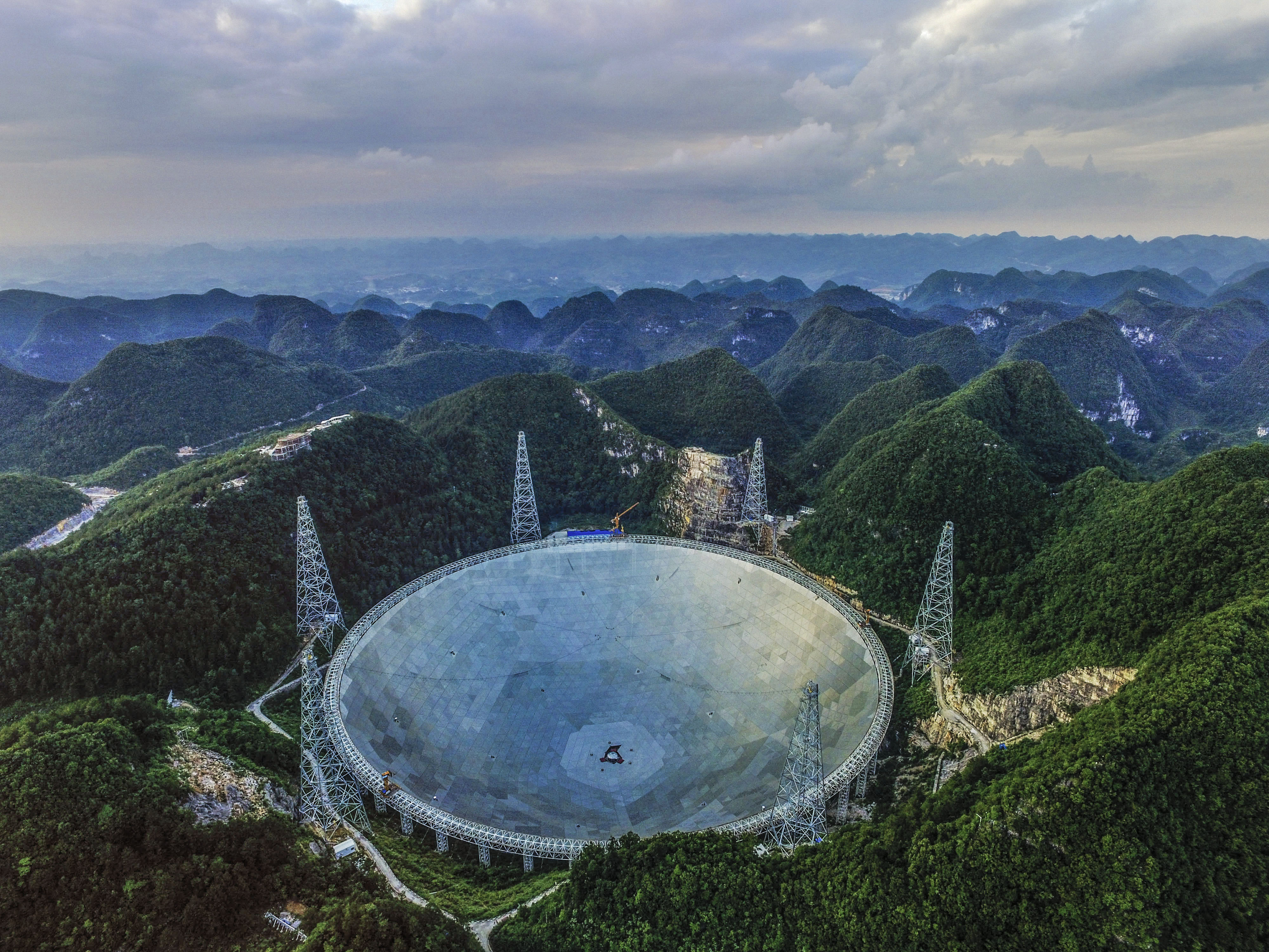 An aerial view of the 500-m Aperture Spherical Telescope (FAST) on June 10, 2016, in Qiannan Buyei and Miao Autonomous Prefecture in China