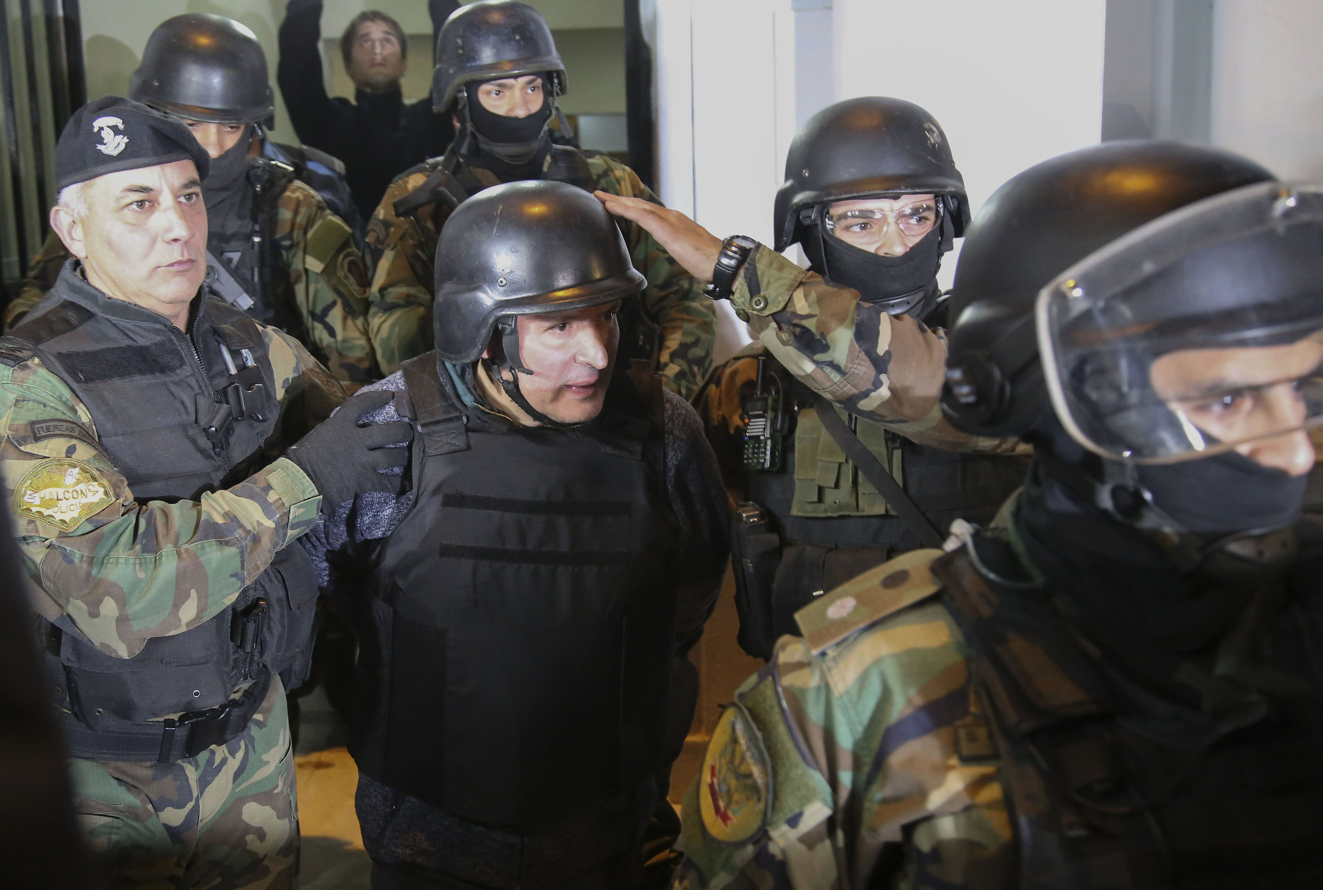 Argentinian former Vice Minister of Public Works Jose Lopez is taken into custody after being arrested in General Rodriguez, province of Buenos Aires on June 14, 2016.
