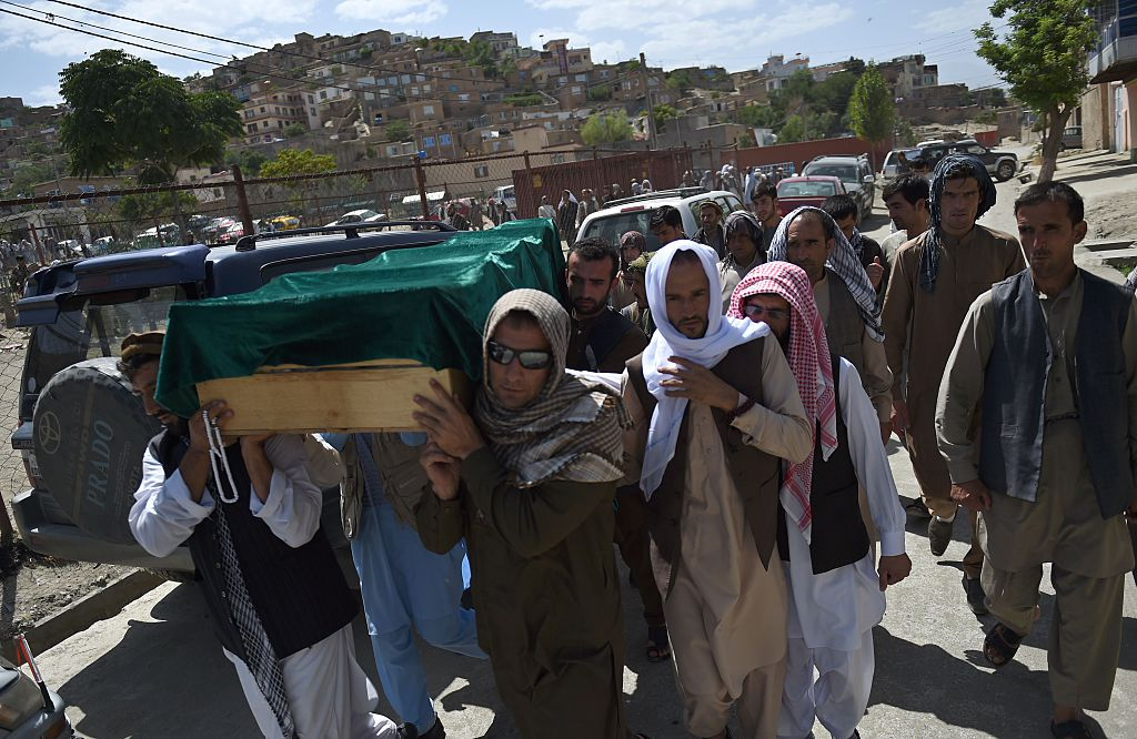 Relatives carry the coffin of Afghan police cadet Mohinddin ahead of his funeral prayers at The Qul Ab Chakan cemetery in Kabul, after his death in a Taliban attack in the Afghan capital, on July 1, 2016.