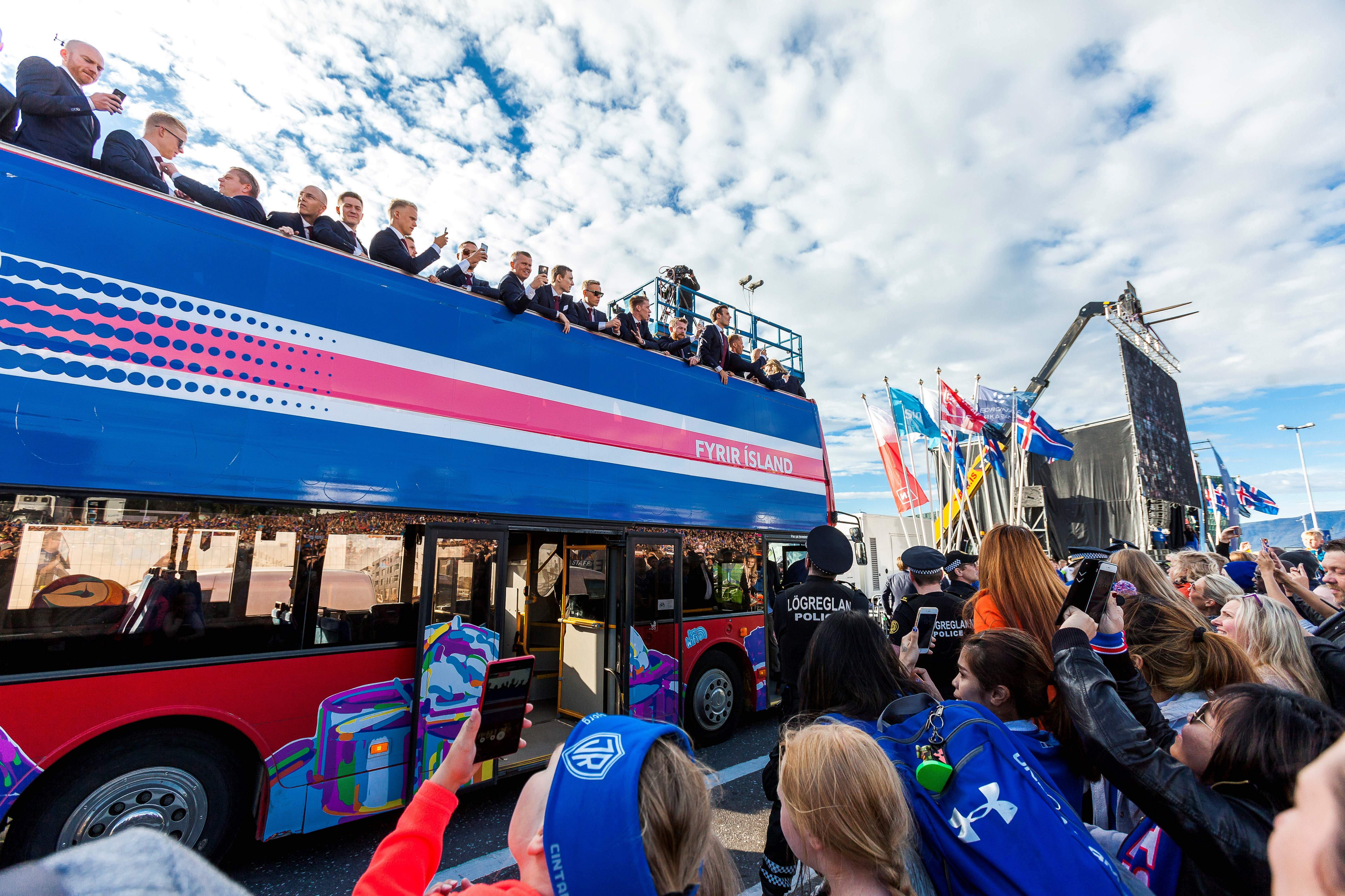 The Iceland national soccer team arrives in Reykjavik on July 4, 2016 on a bus after they lost against France during the the Euro 2016 quarterfinal the day before.