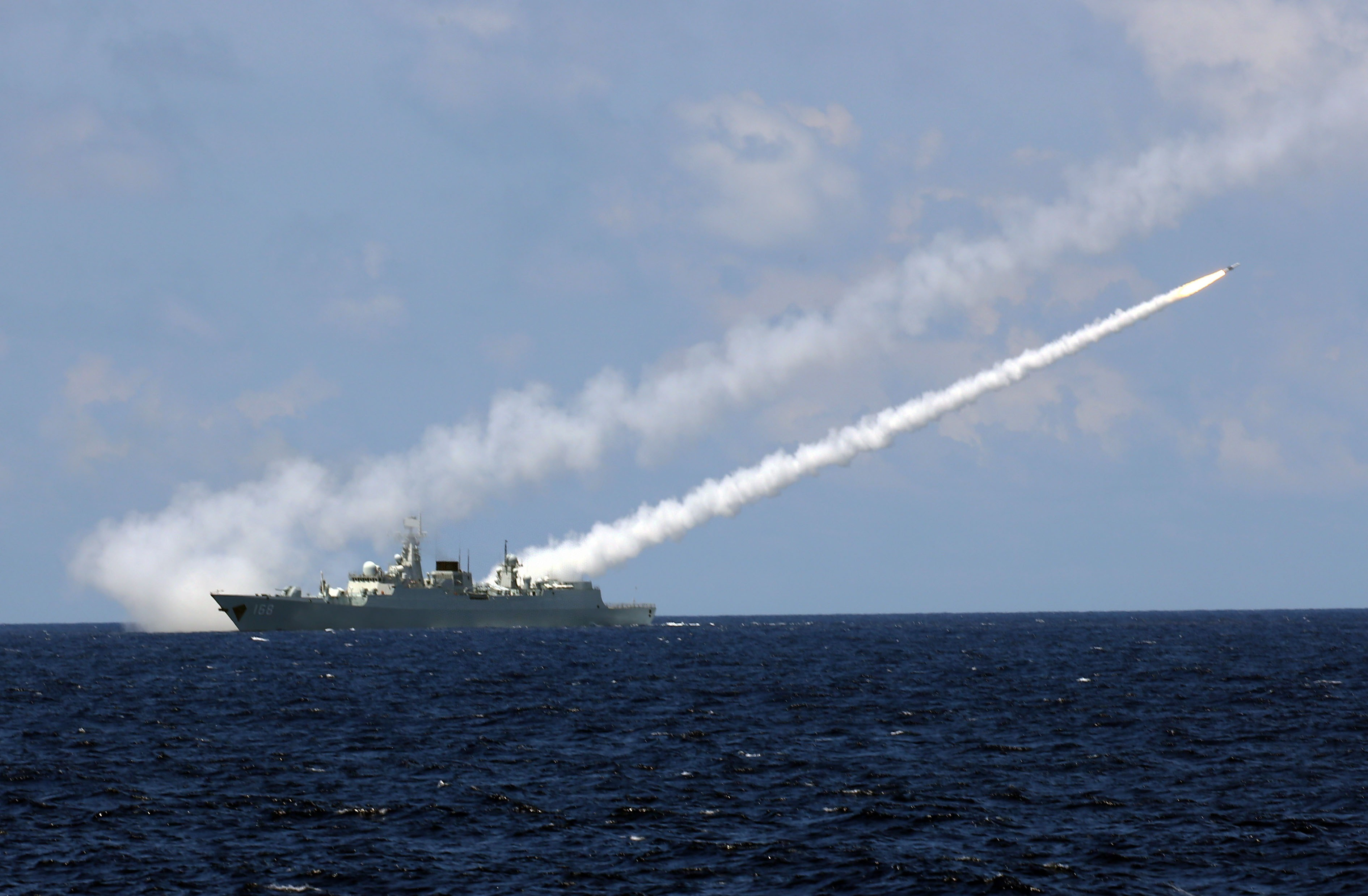 Missile destroyer Guangzhou launches an air-defense missile during a military exercise in the water area near south China's Hainan Island and Xisha islands on July 8, 2016