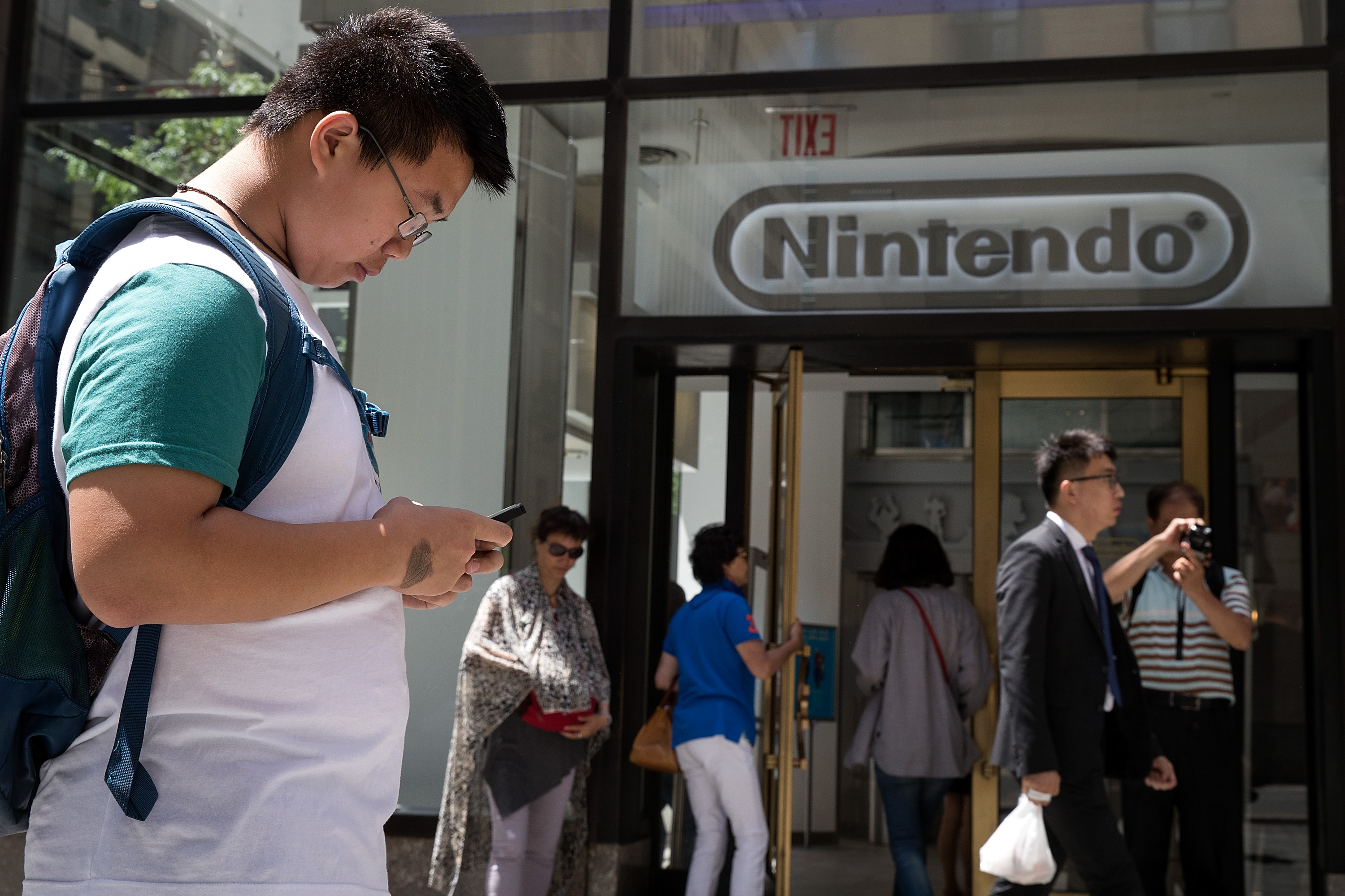 Tim (last name not given) plays Pokemon Go on his smartphone outside of Nintendo's flagship store, July 11, 2016, in New York City. The success of Nintendo's new smartphone game, Pokemon Go, has sent shares of Nintendo soaring