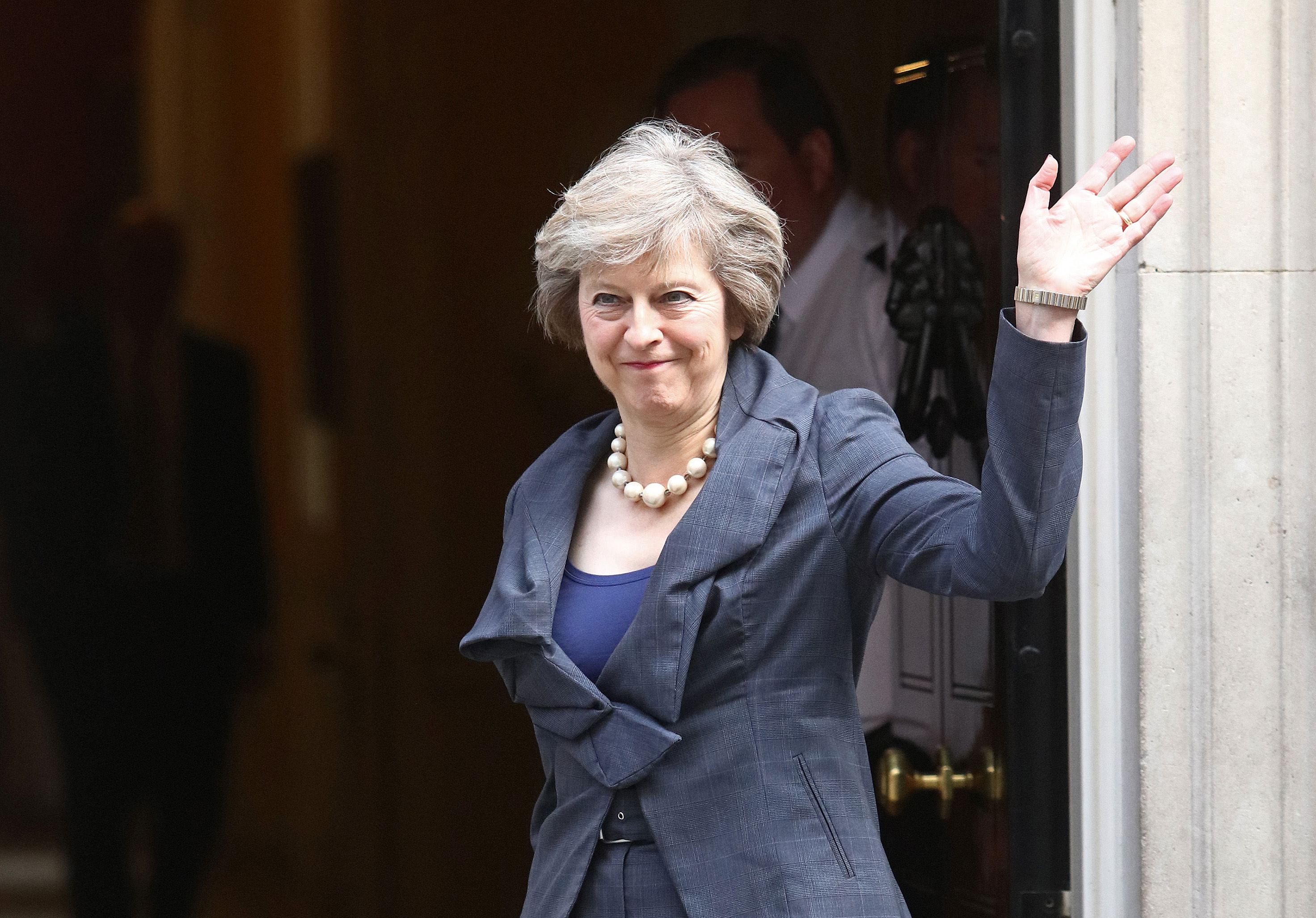 Theresa May, U.K. home secretary, waves as she arrives for a cabinet meeting in 10 Downing Street in London, on July 12, 2016.