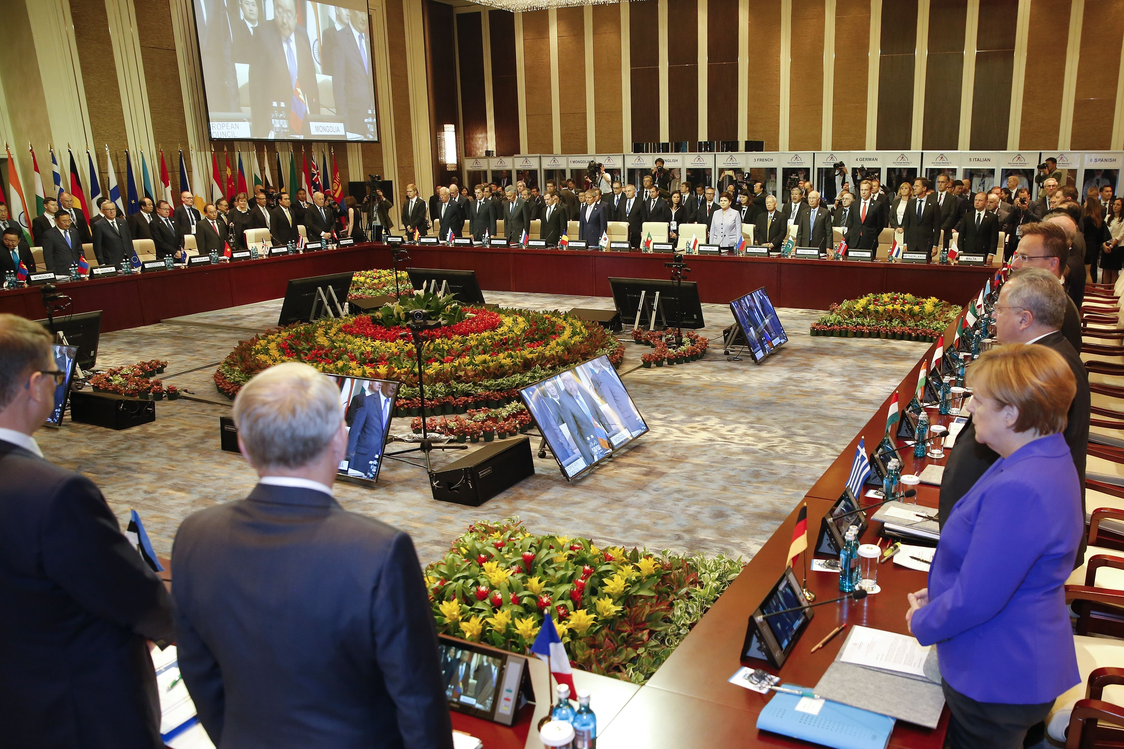 Leaders stand for a minute of silence for the victims of a deadly attack in the French city of Nice, before the opening session of the 11th Asia-Europe Meeting (ASEM) Summit in the Mongolian capital of Ulan Bator on July 15, 2016.