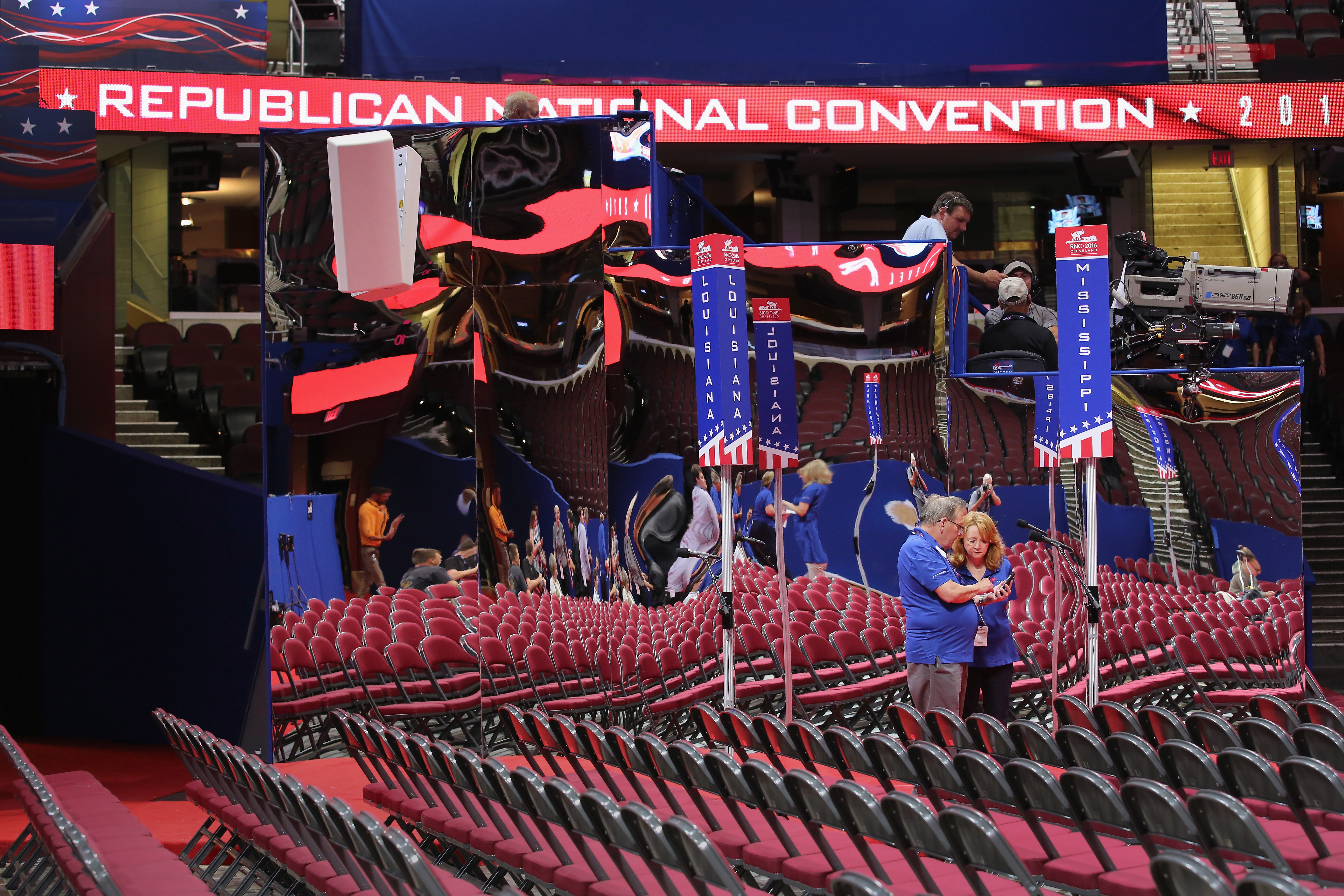 vent workers compare photos on the floor of the Quicken Loans Arena ahead of the Republican National Convention on July 16, 2016 in Cleveland, Ohio.