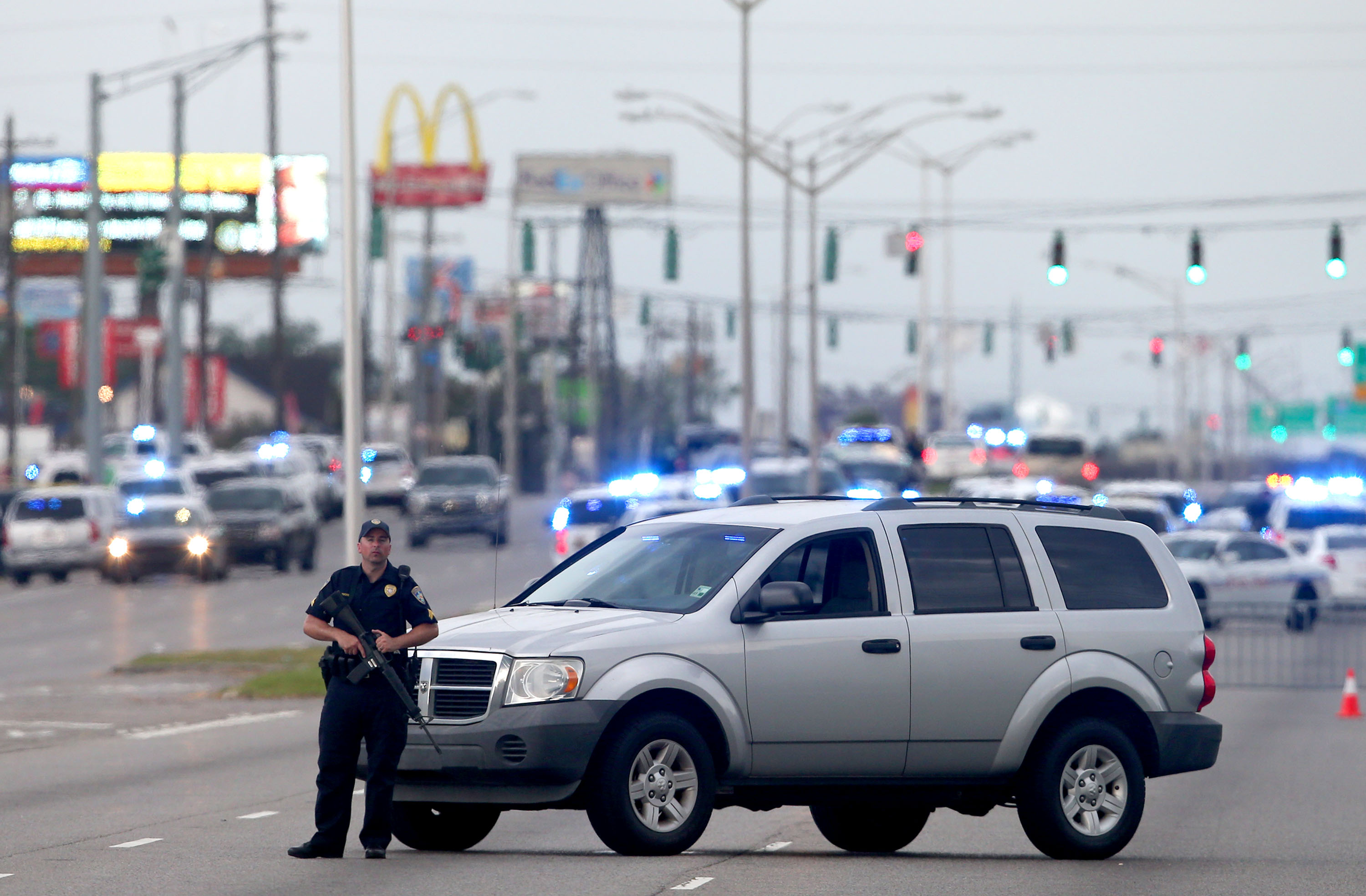 An East Baton Rouge Police officer patrols Airline Hwy after 3 police officers were killed early this morning on July 17, 2016 in Baton Rouge, Louisiana