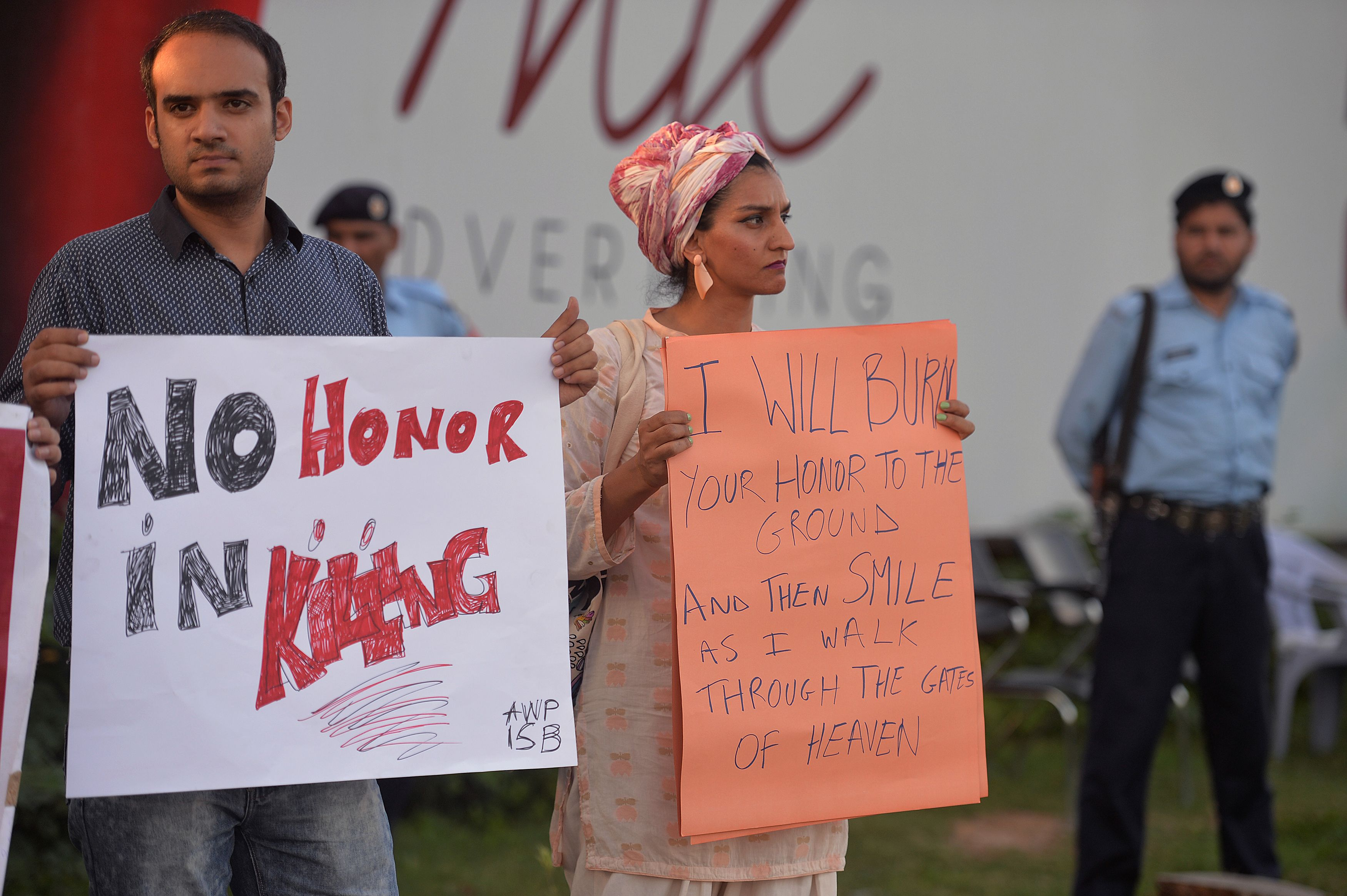 Pakistani civil-society activists carry placards during a protest in Islamabad on July 18, 2016, against the murder of social-media celebrity Qandeel Baloch by her own brother