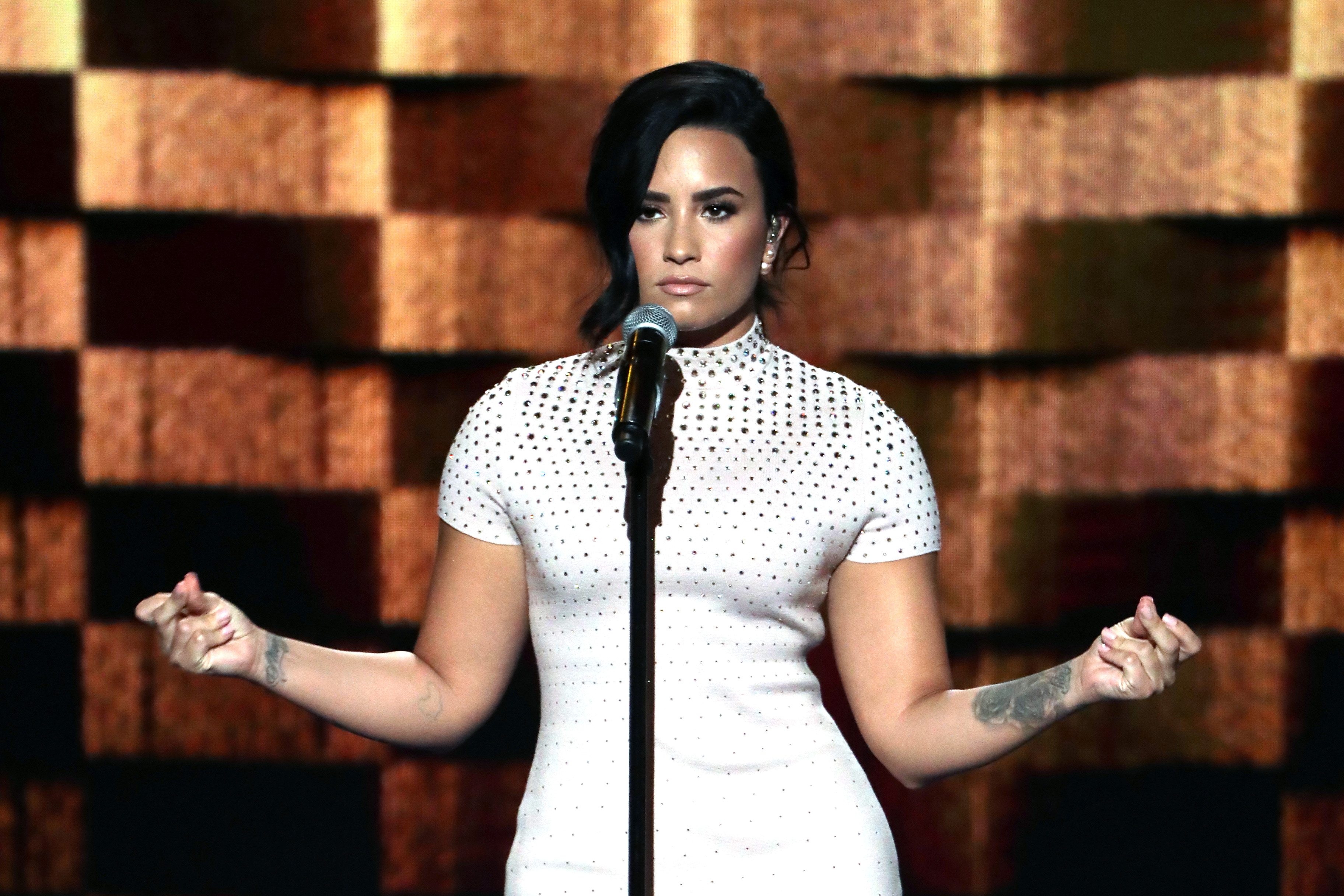 Singer Demi Lovato performs on stage during the first day of the Democratic National Convention at the Wells Fargo Center in Philadelphia on July 25, 2016.