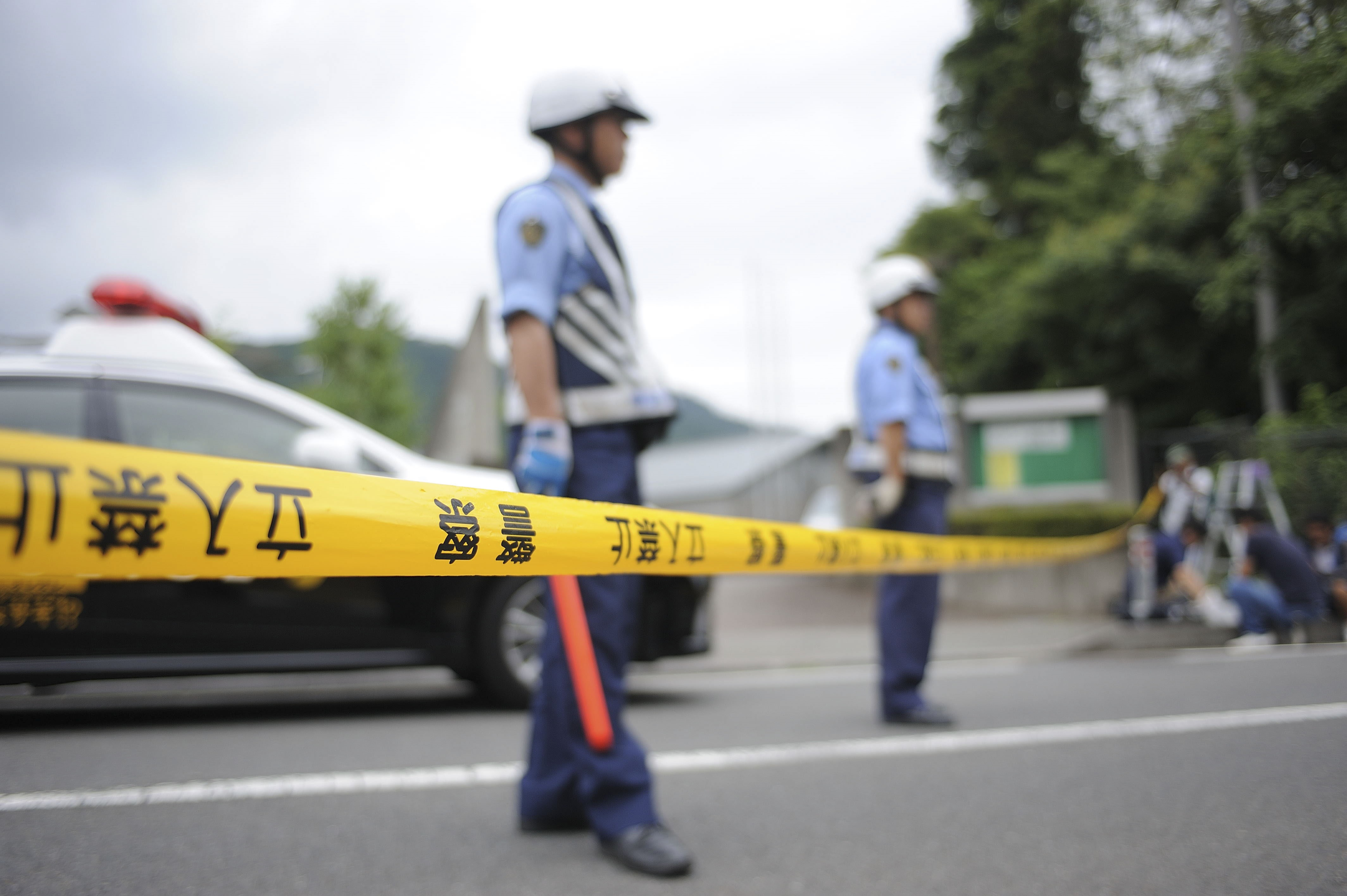 Police are seen on the site where Satoshi Uematsu carried out a knife attack in a residential care center on July 26, 2016, in Sagimahara city, Kanagawa Prefecture, Tokyo, Japan.