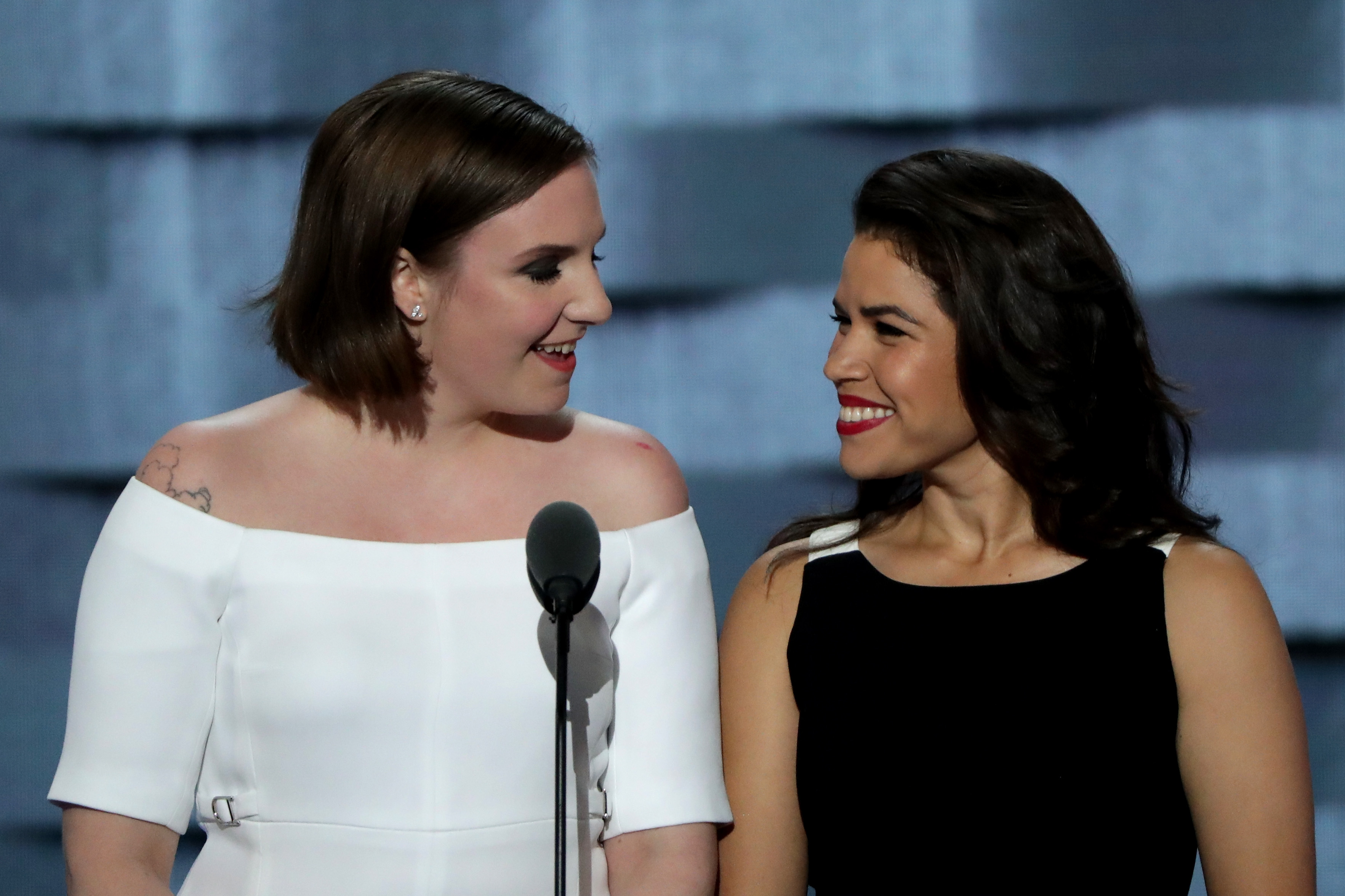 Actresses America Fererra (R) and Lena Dunham (L) arrive on stage to deliver remarks on the second day of the Democratic National Convention at the Wells Fargo Center, July 26, 2016 in Philadelphia, Pennsylvania.