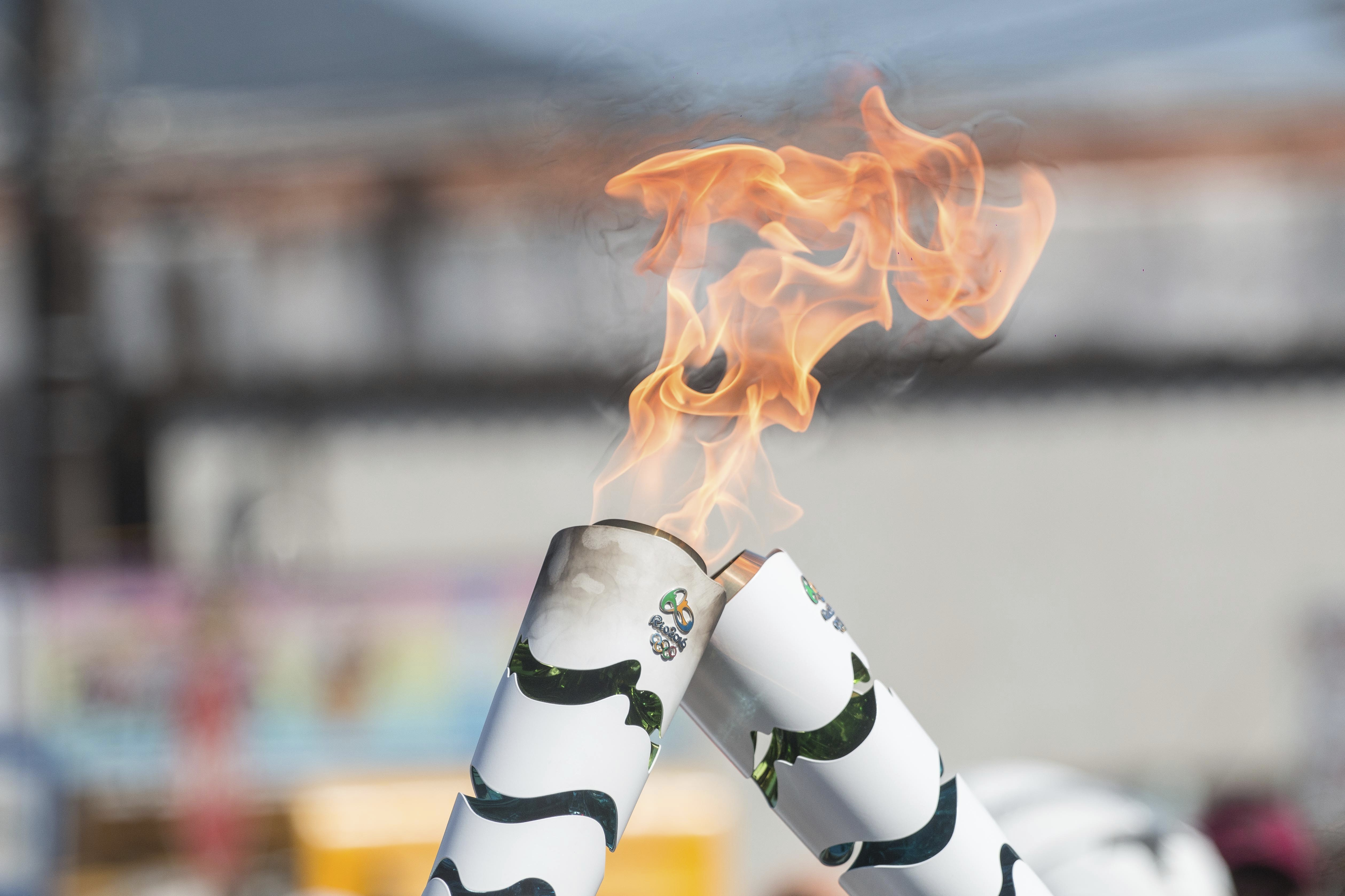 The Olympic torch and flames during Official Torch Relay on July 23, 2016 in Ubatuba, , Brazil.