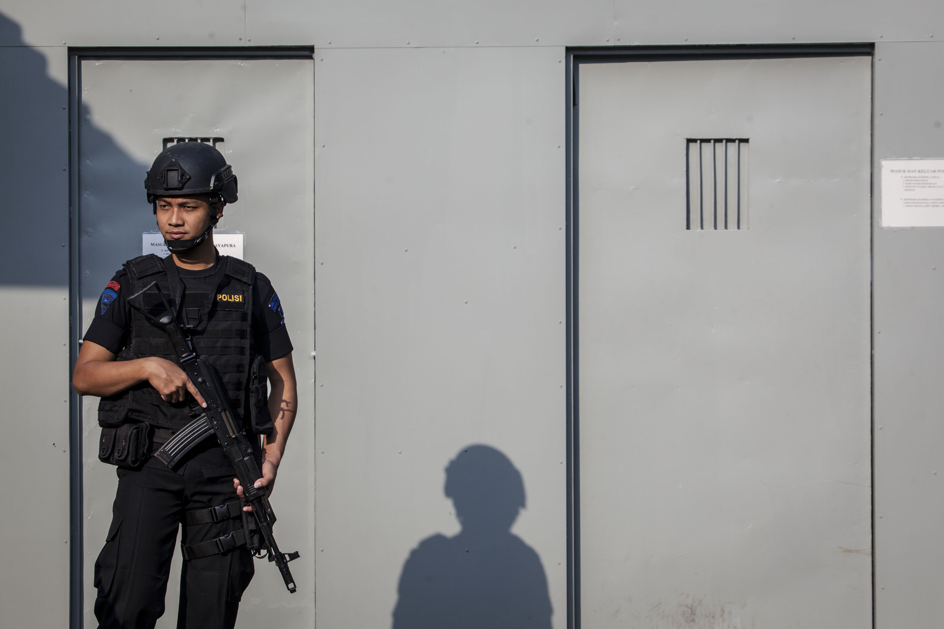 An Indonesian policeman stands guard at the entrance gate to Nusakambangan prison, ahead of a third round of drug executions on July 28, 2016 in Cilacap, Central Java, Indonesia.