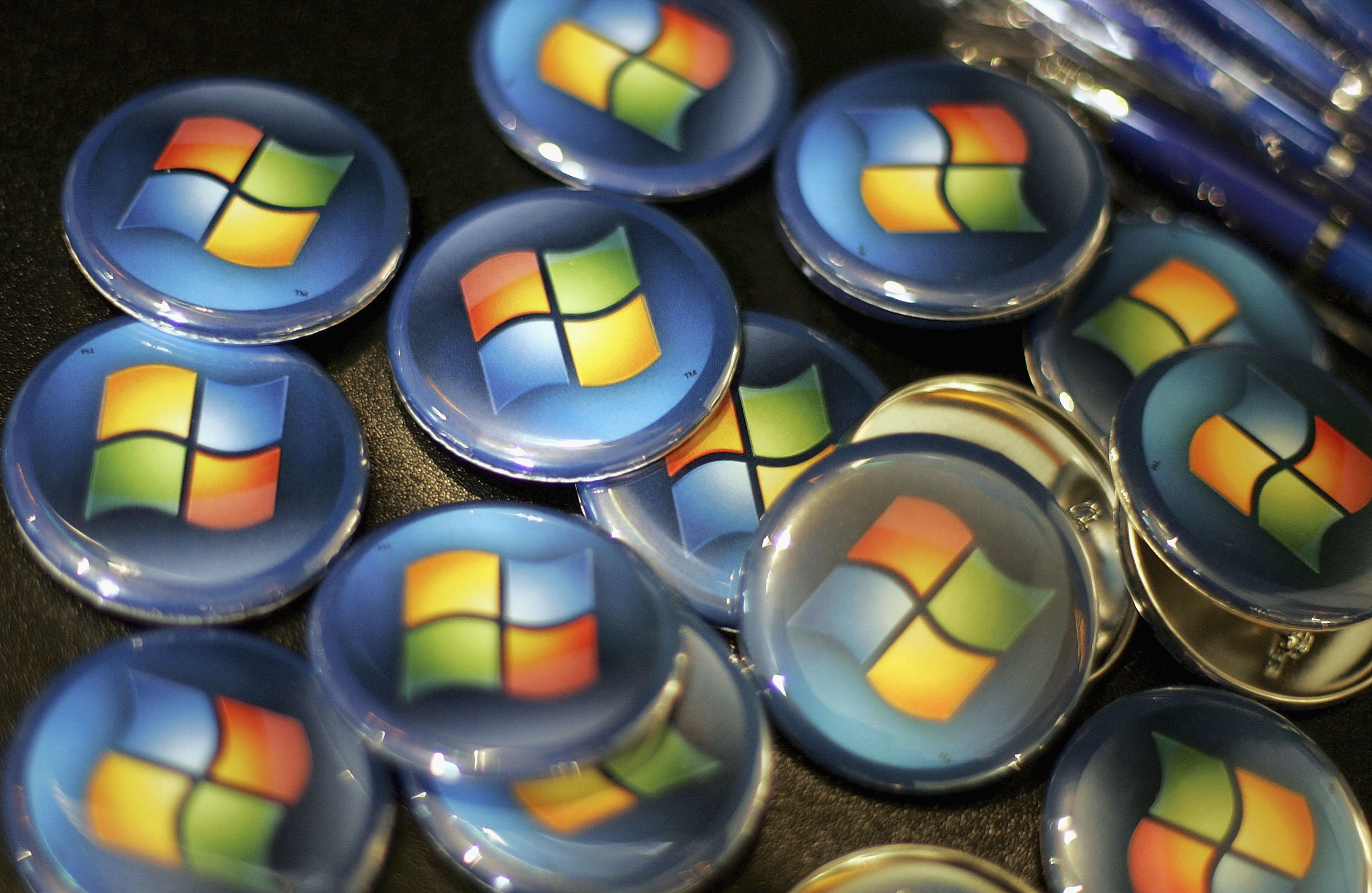 Buttons with the Microsoft logo are seen at a Comp USA store January 29, 2007 in San Francisco, California