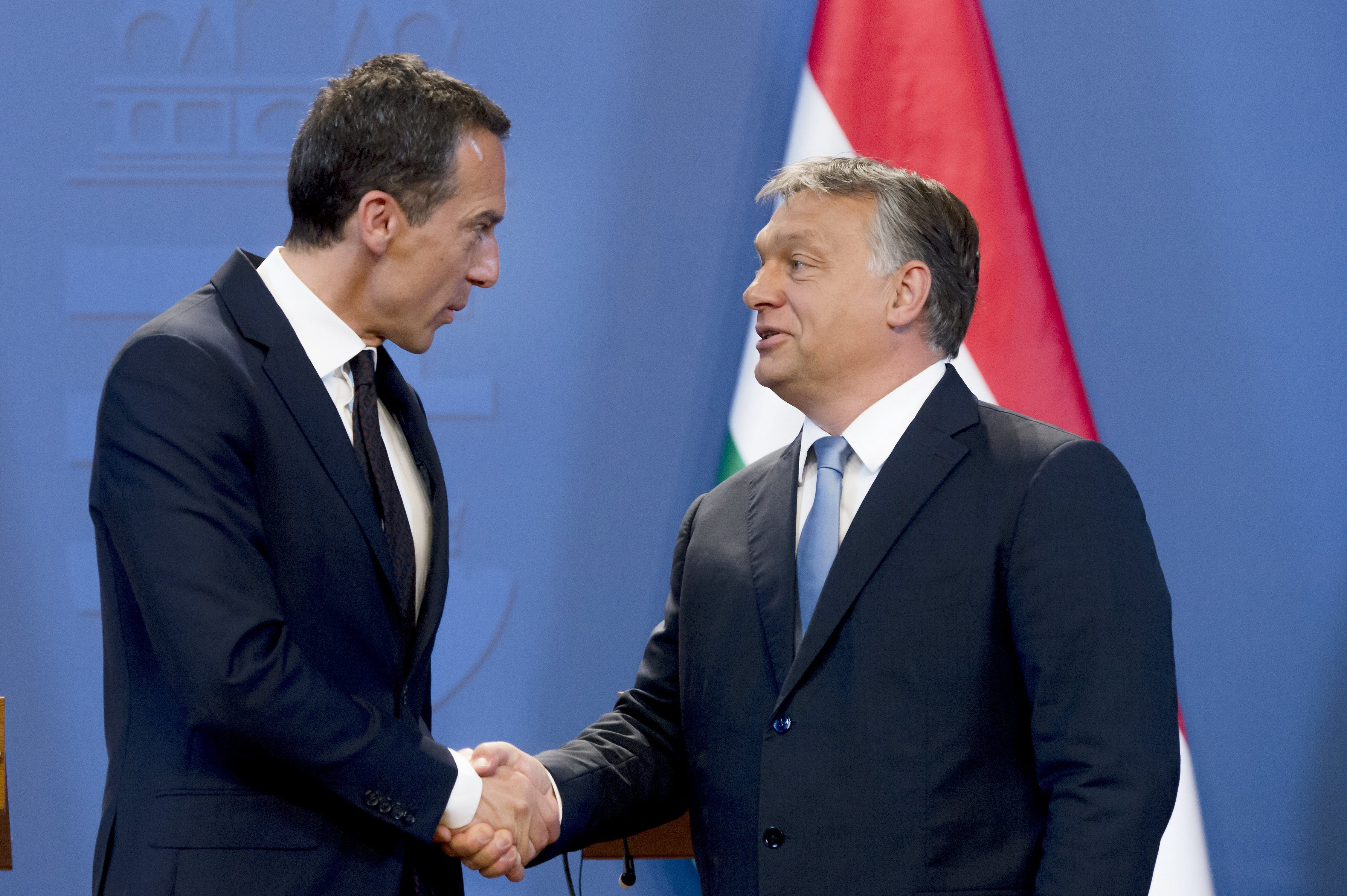 Austrian Federal Chancellor Christian Kern (L) and Hungarian Prime Minister Viktor Orban (R) shake hands after their joint press conference at the Delegation Room of the Parliament in Budapest, Hungary on July 26 2016