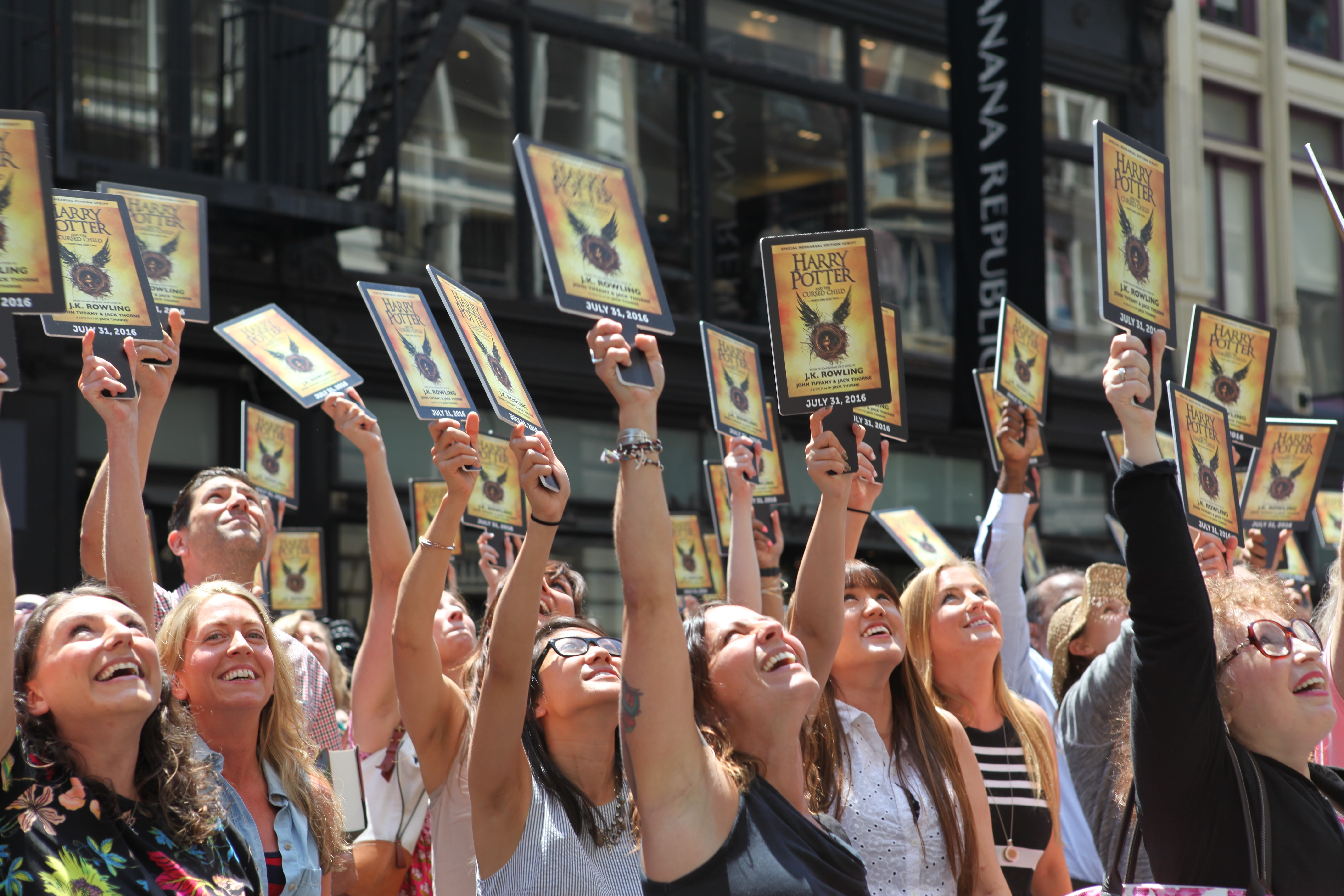 """A """"Muggle Mob"""" of 300 Harry Potter fans fills the street in front of the Scholastic headquarters building in New York City on July 21, 2016 to celebrate the upcoming release of Harry Potter and the Cursed Child Parts One and Two."""