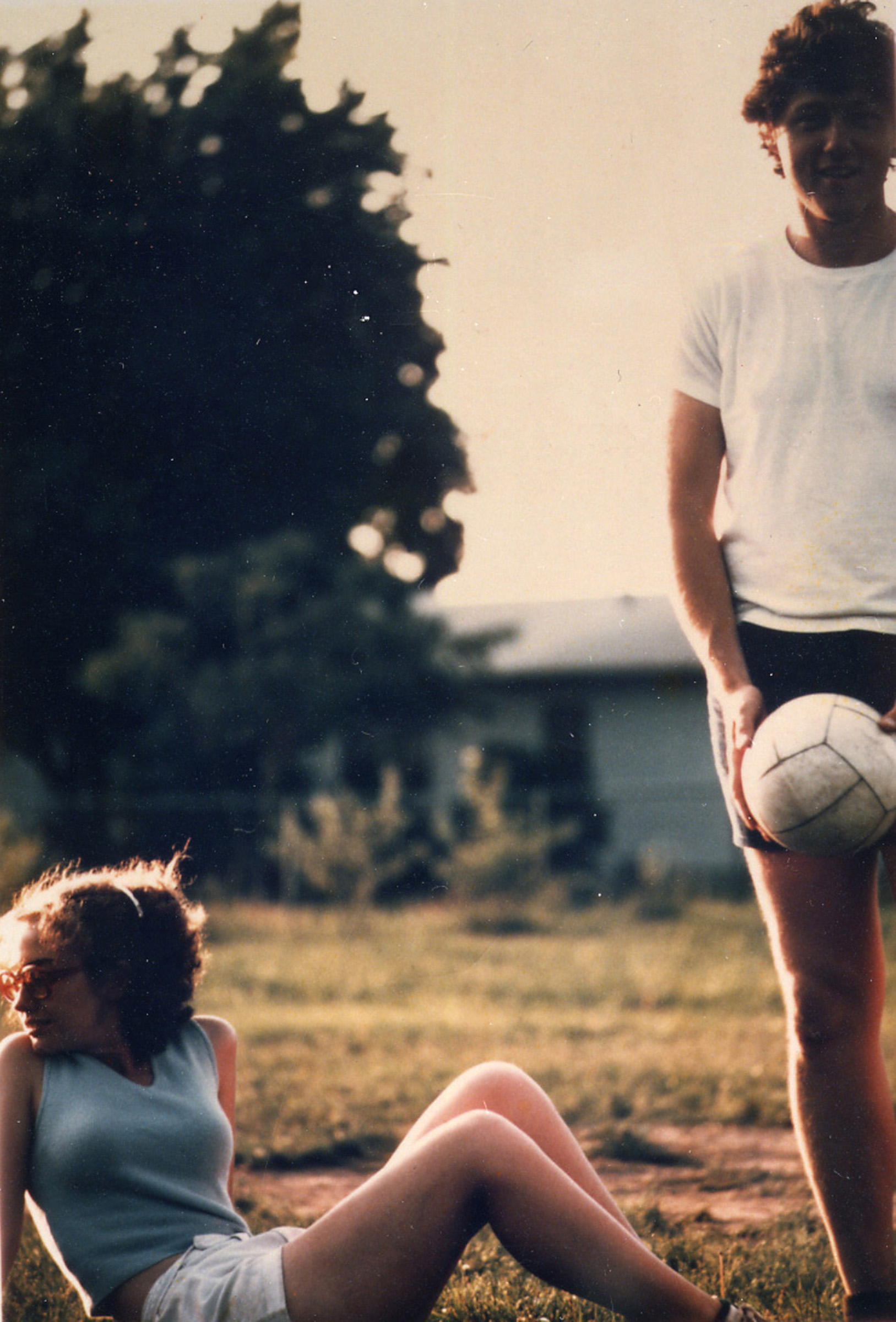 Hillary and Bill playing volleyball, Fayetteville, N.C., 1975.