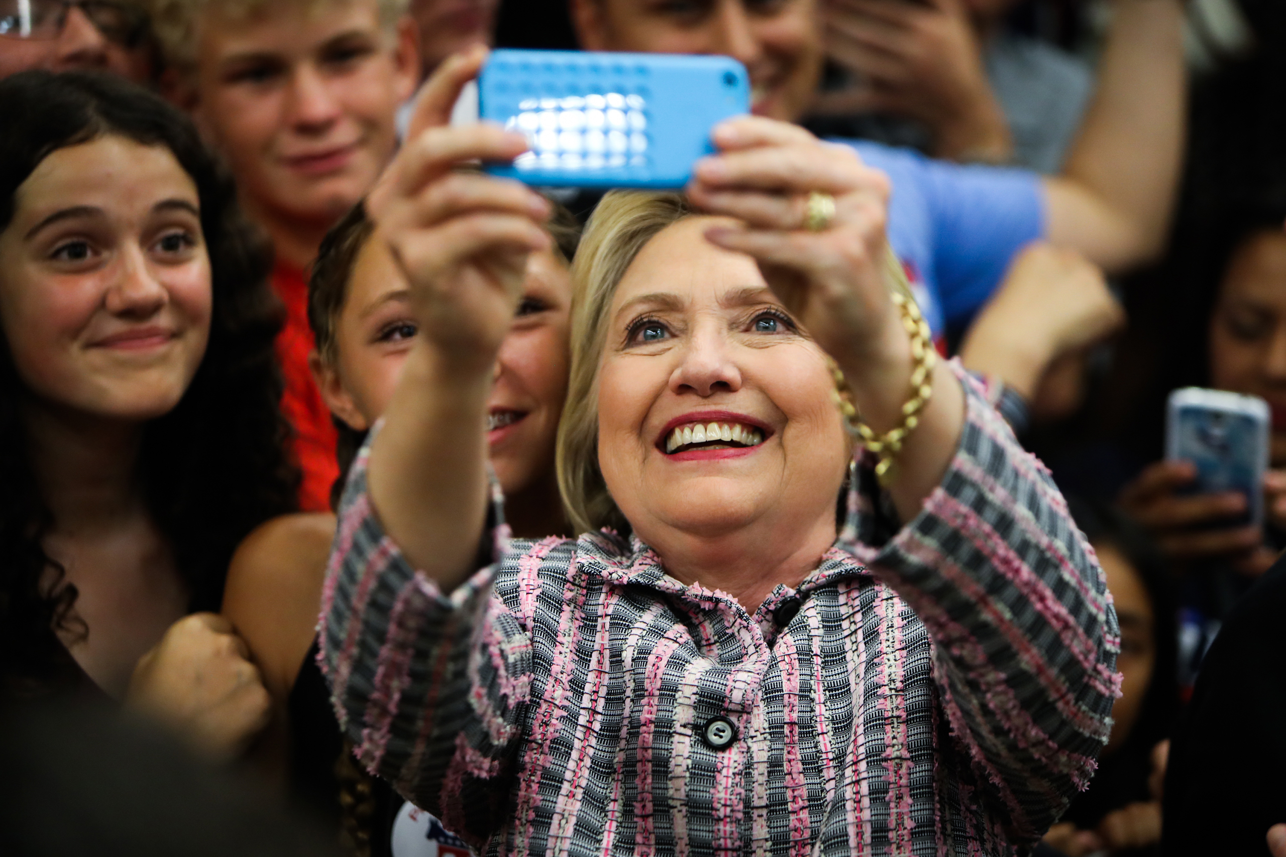 Hillary Clinton takes photographs with supporters after a campaign rally at Sacramento City College in Calif. on June 5, 2016.