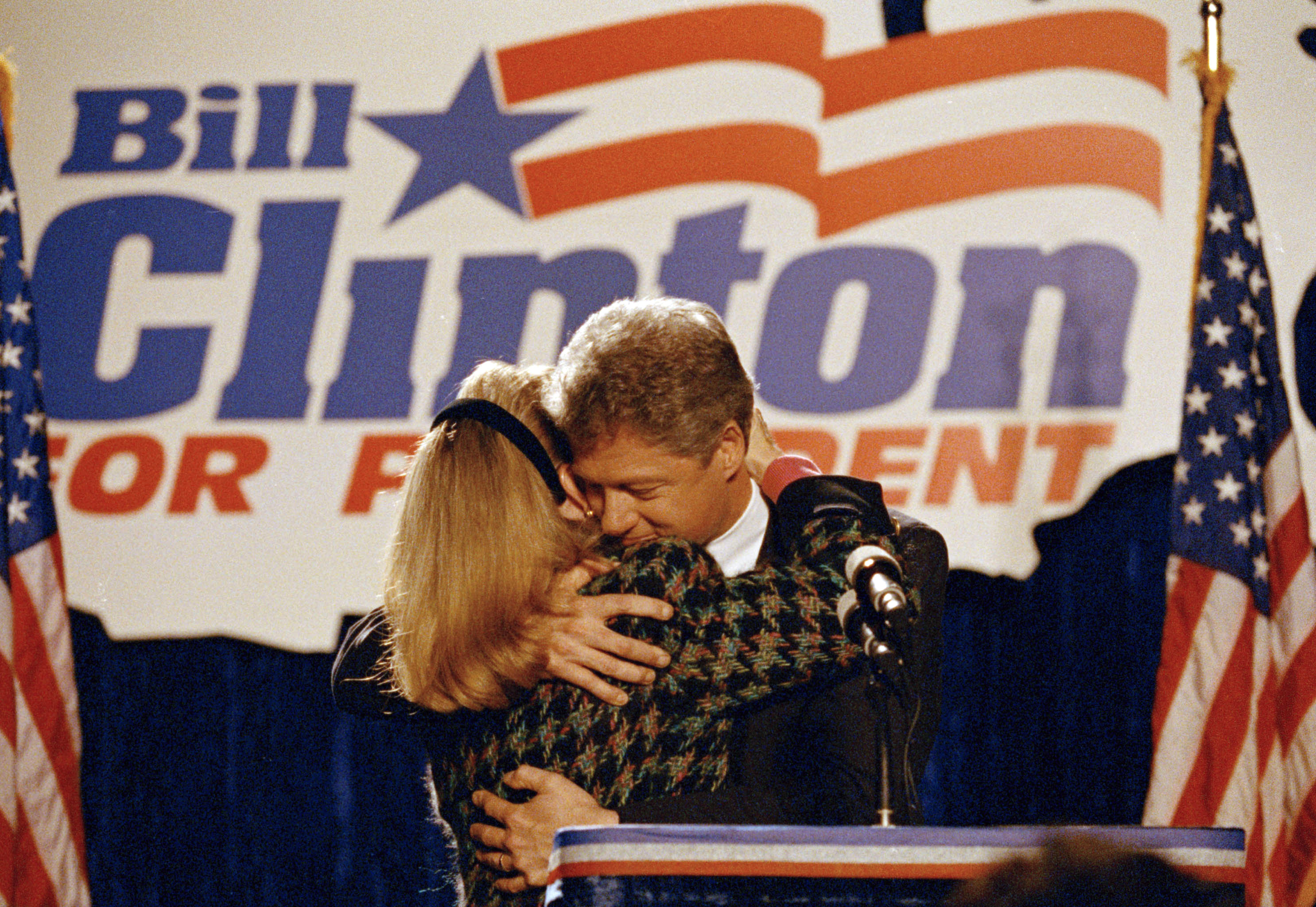Democratic presidential candidate Bill Clinton hugs his wife Hillary Clinton after she introduced him to well wishers at a downtown Chicago hotel, March 10, 1992.