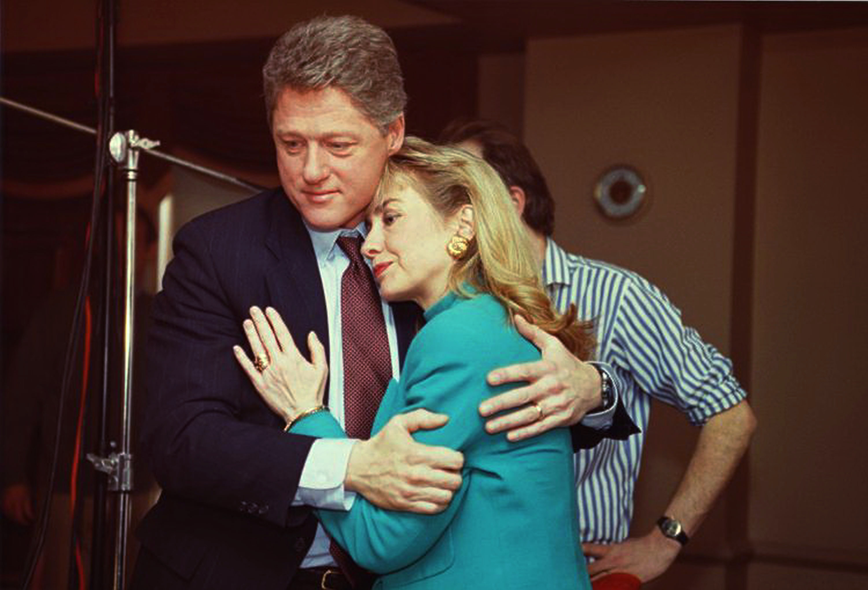 Arkansas Gov. Bill Clinton comforts his wife Hillary Rodham Clinton on the set of the news program '60 Minutes' after a stage light unexpectedly broke loose from the ceiling and knocked her down on Jan. 26, 1992.