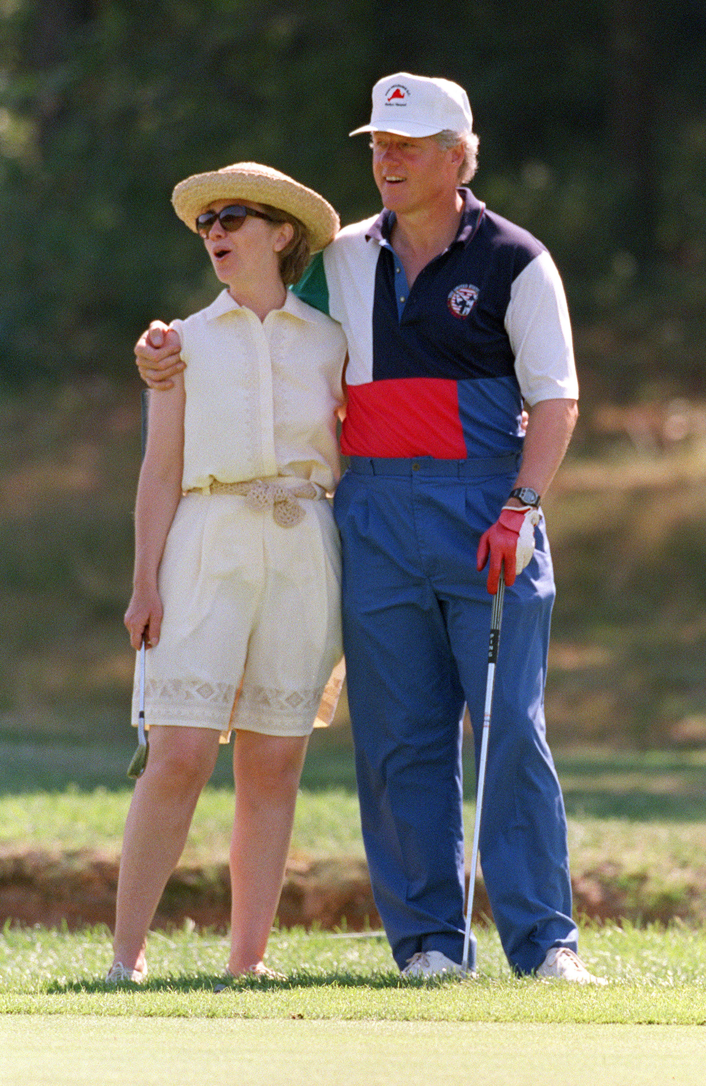 President Bill Clinton and First Lady Hillary Clinton give each other a hug while playing golf at the Mink Meadows Golf Club on Martha's Vineyard Aug. 27,1993 in Massachusetts.