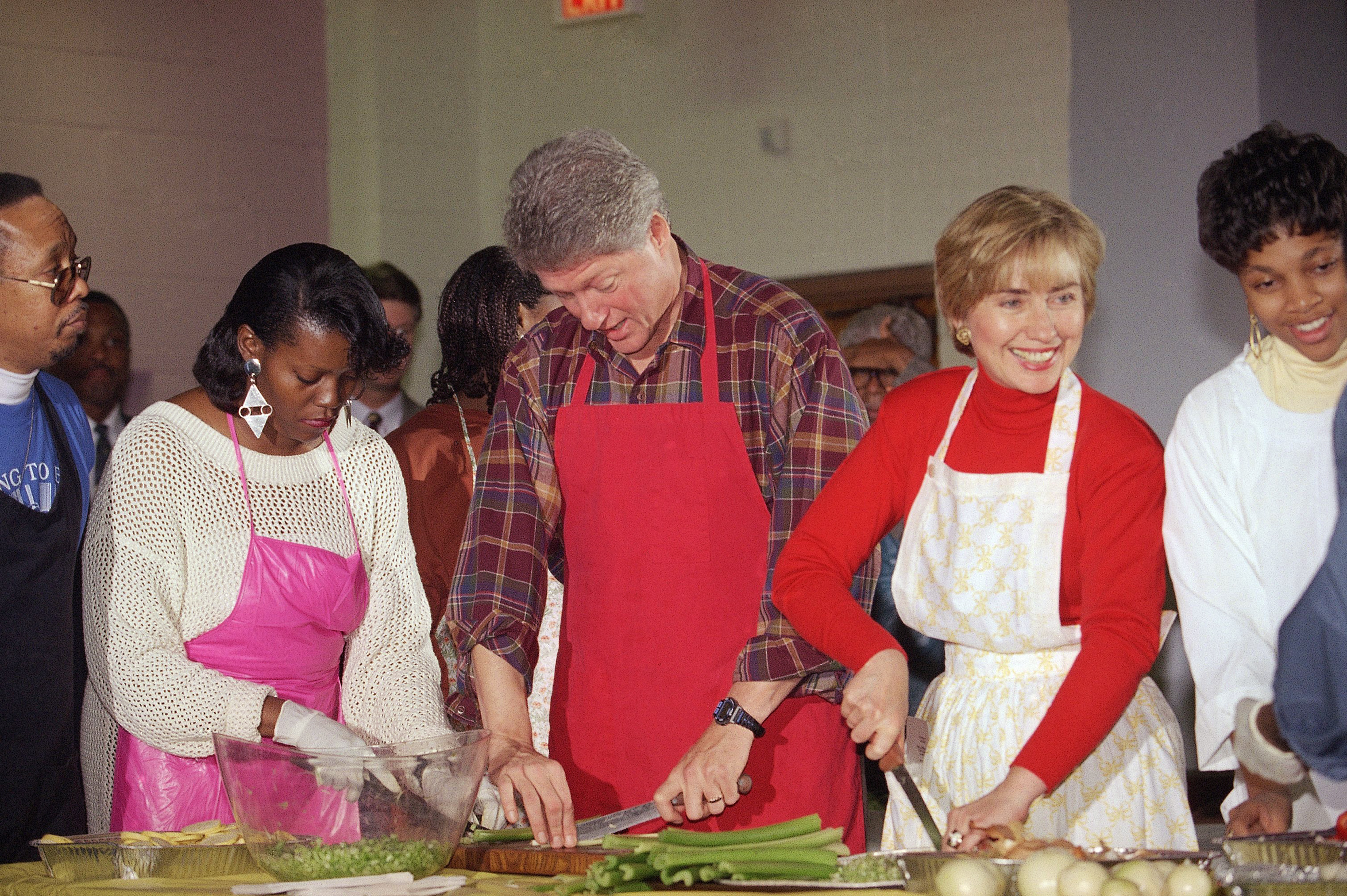 President Bill Clinton and First Lady Hillary Rodham Clinton cut vegetables at the Covenant Baptist Church in Washington, on Nov. 24, 1993.