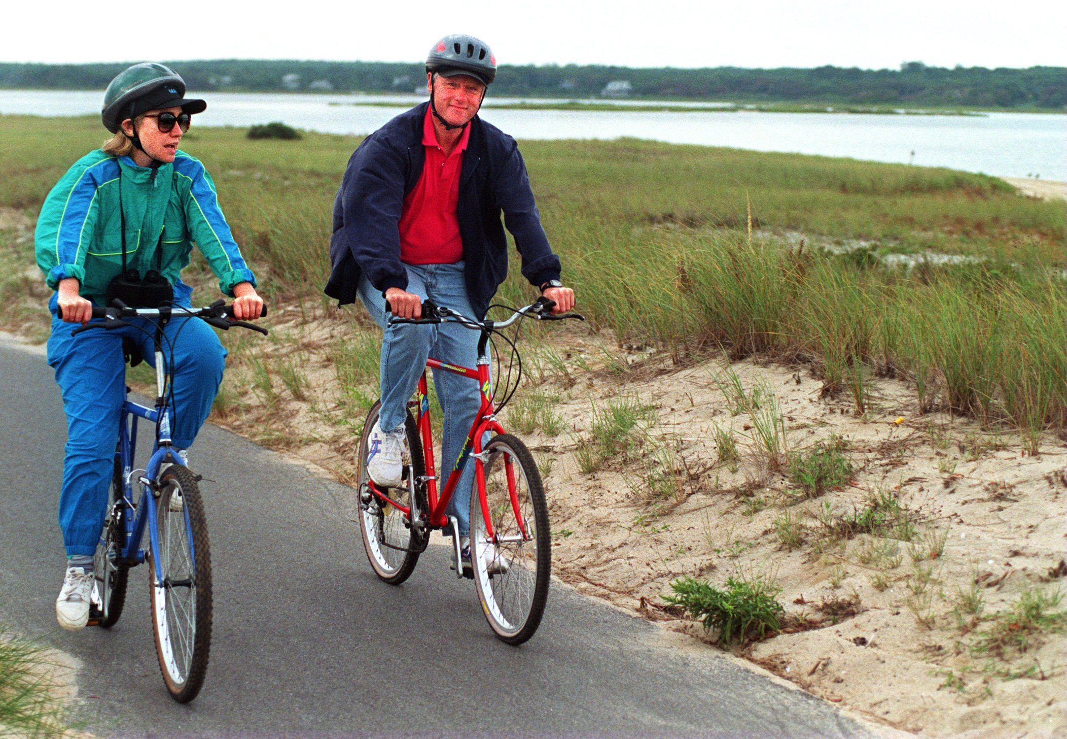 President Bill Clinton bikes with his wife, Hillary Clinton, during their vacation on Martha's Vineyard in 1994.