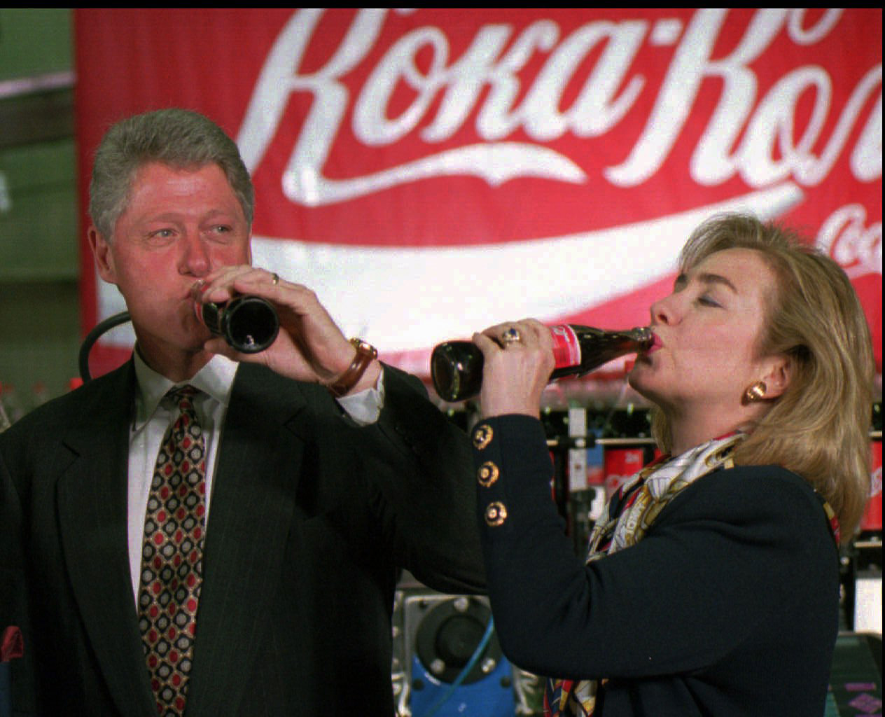 President Bill Clinton and First Lady Hillary Rodham Clinton drink Coca-Cola at Moscow's Coca-Cola refreshments plant on May 11, 1995.