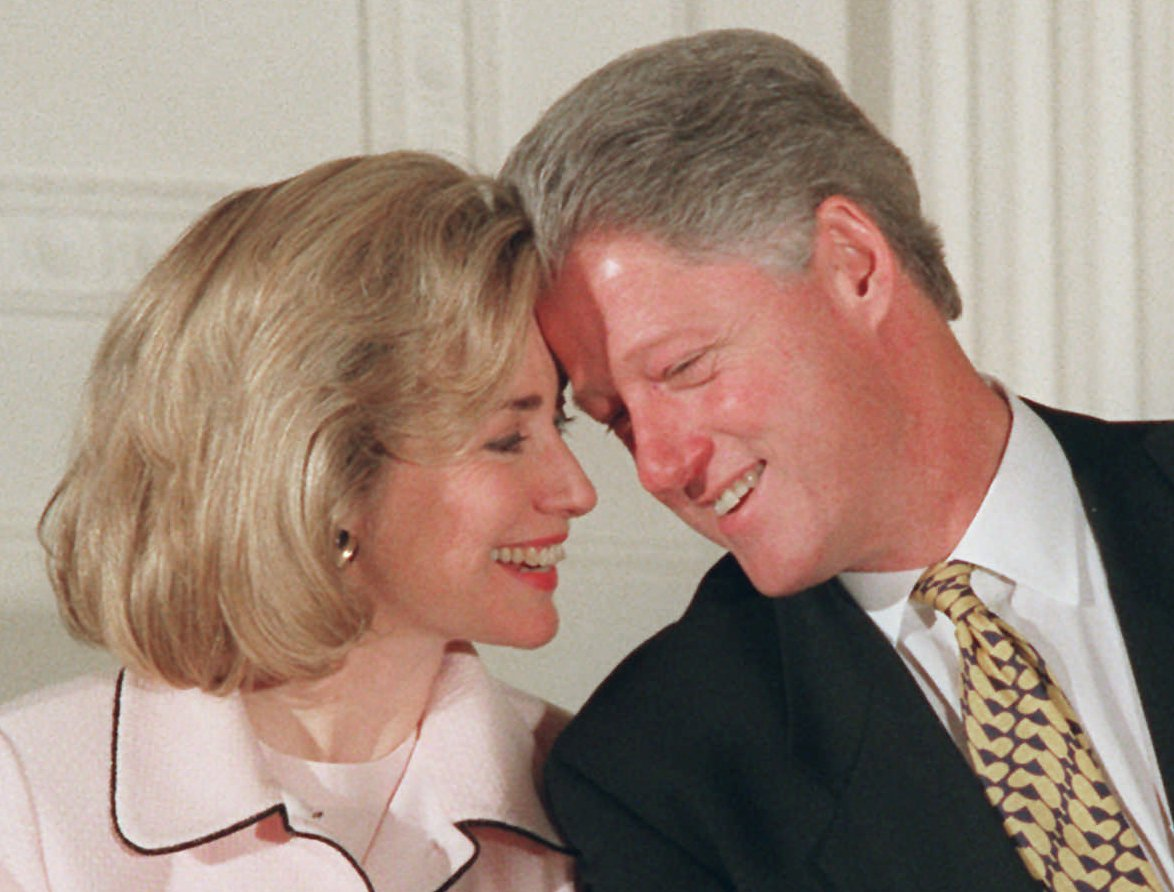 President Bill Clinton and First Lady Hillary Clinton share a moment during an East Room ceremony at the White House on July 17, 1996.
