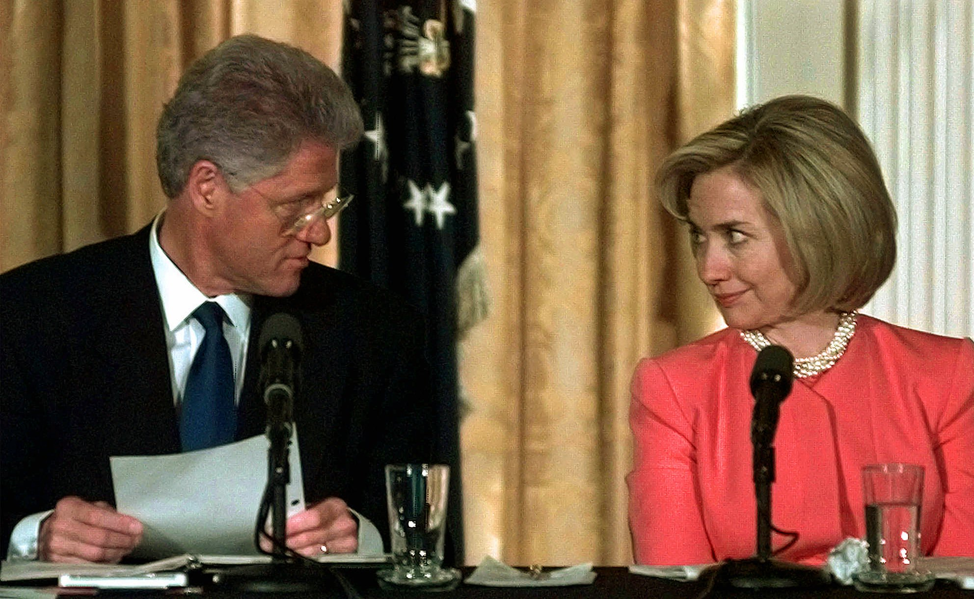 President Bill Clinton and his wife Hillary Rodham Clinton look at each other as they opened the White House Conference on Child Care Thursday Oct. 23, 1997 in the East Room of the White House.