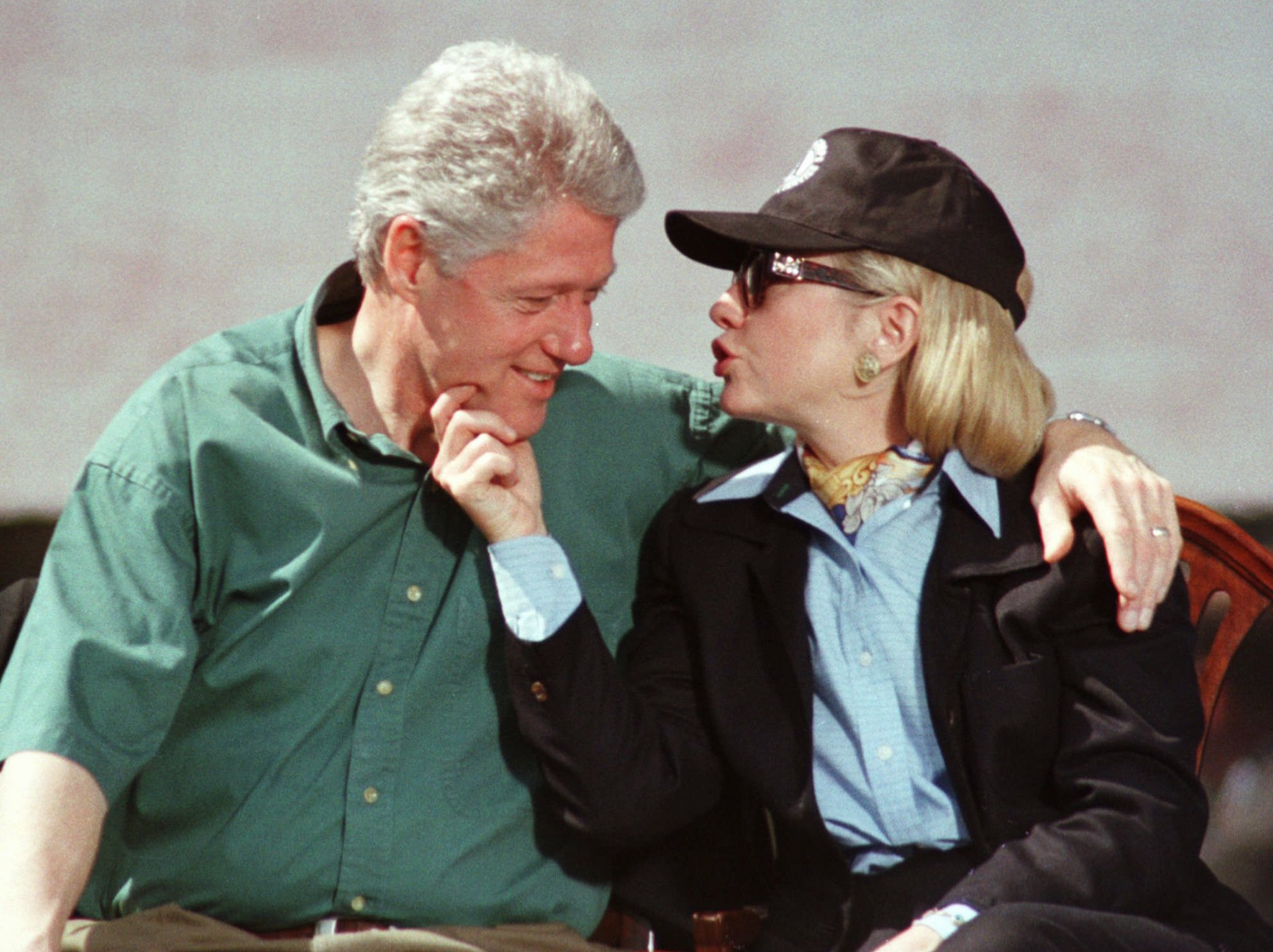 First lady Hillary Rodham Clinton, squeezes the chin of President Bill Clinton during the kick-off rally for The President's Summit in Philadelphia on April 27, 1997.